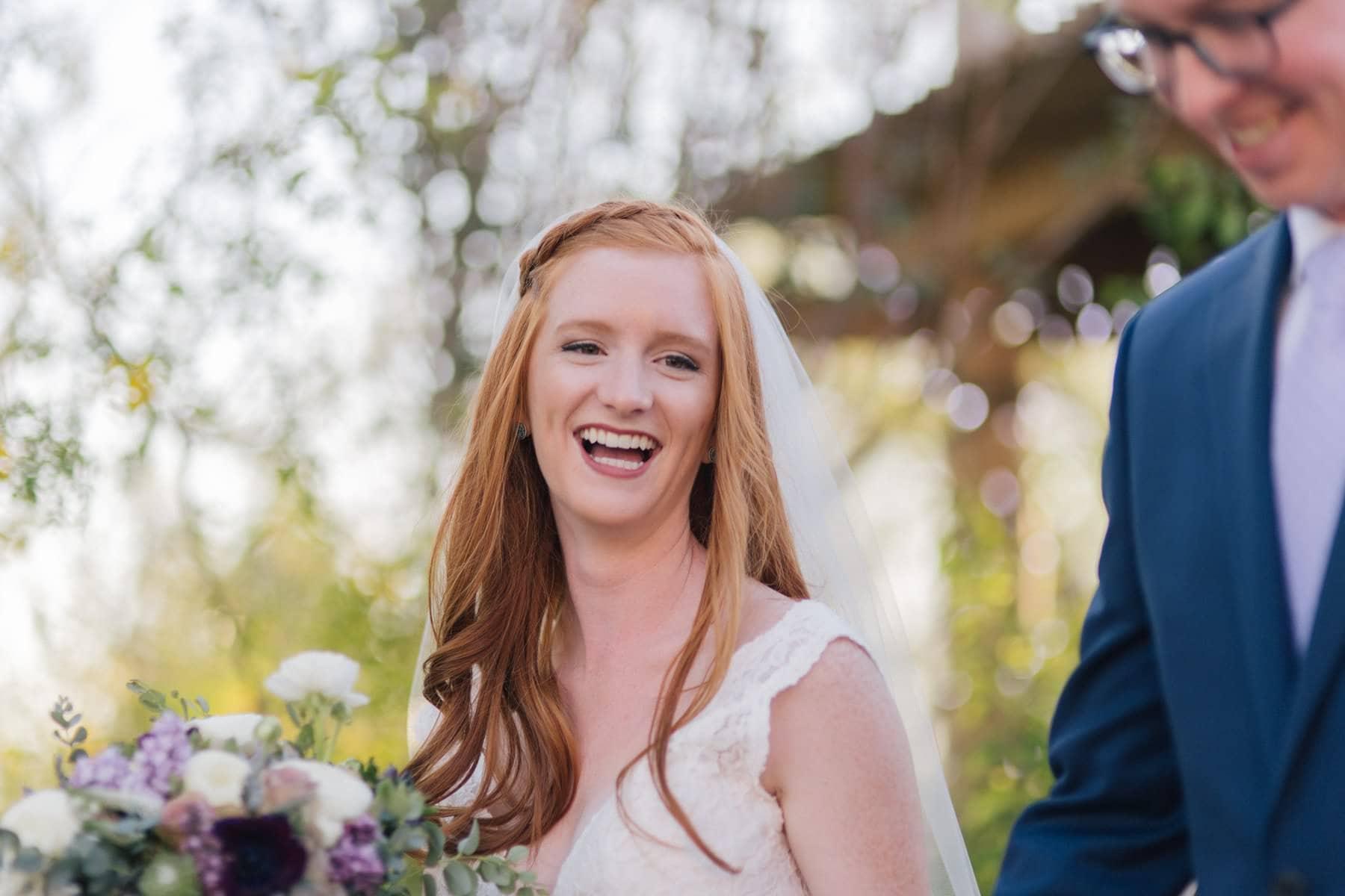 happy laughing redhead bride Phoenix Zoo wedding
