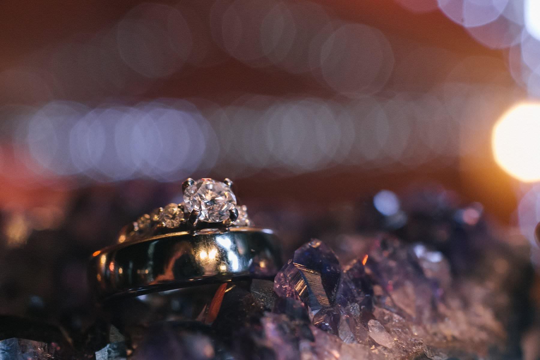 Phoenix wedding rings on top of amethyst boho wedding