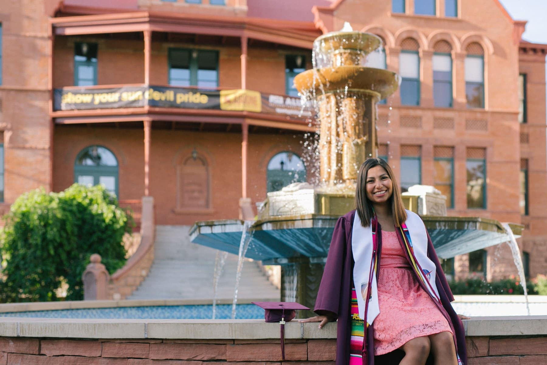 ASU graduation photos in front of Old Main fountain