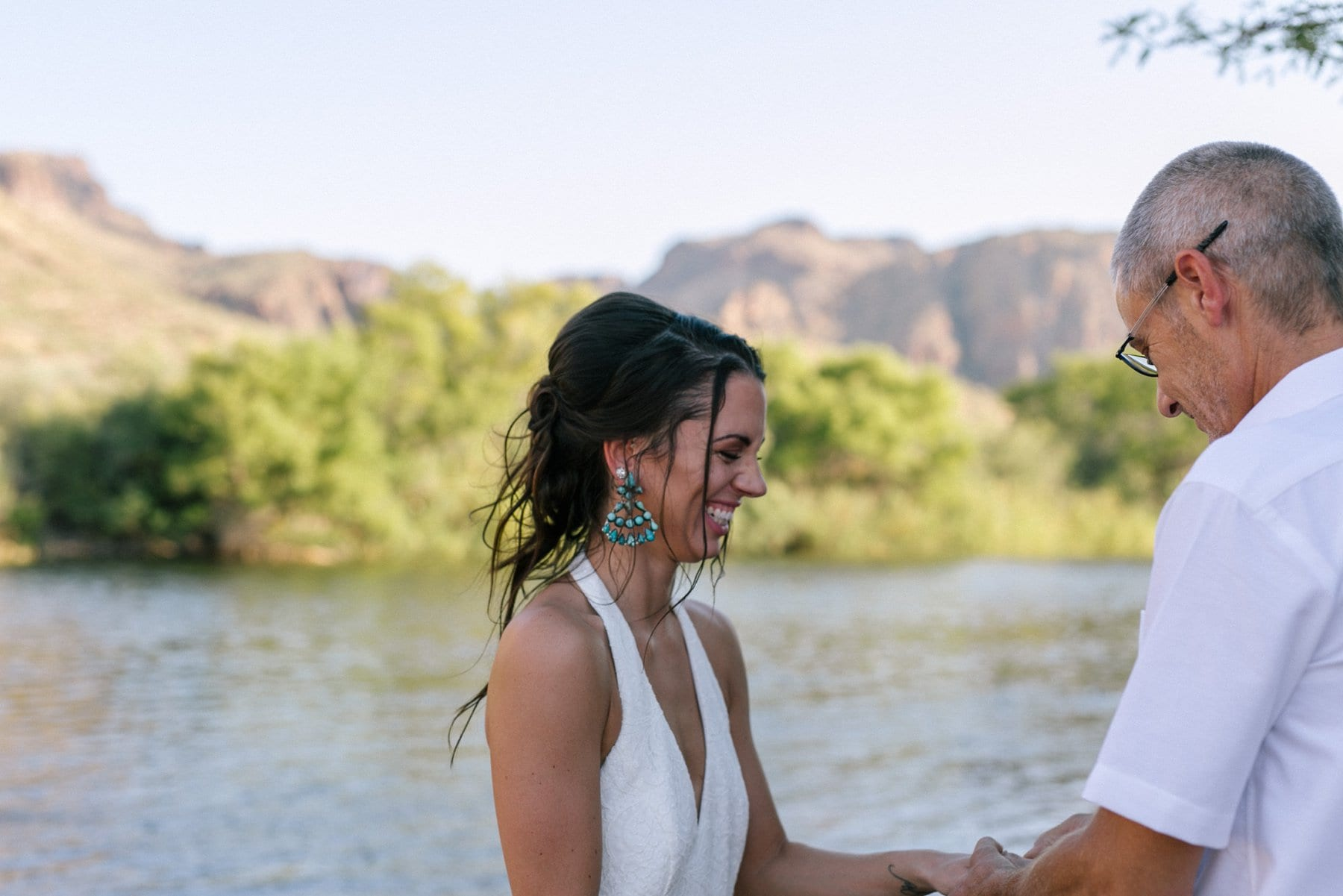 Arizona outdoor elopement at Salt River exchanging rings