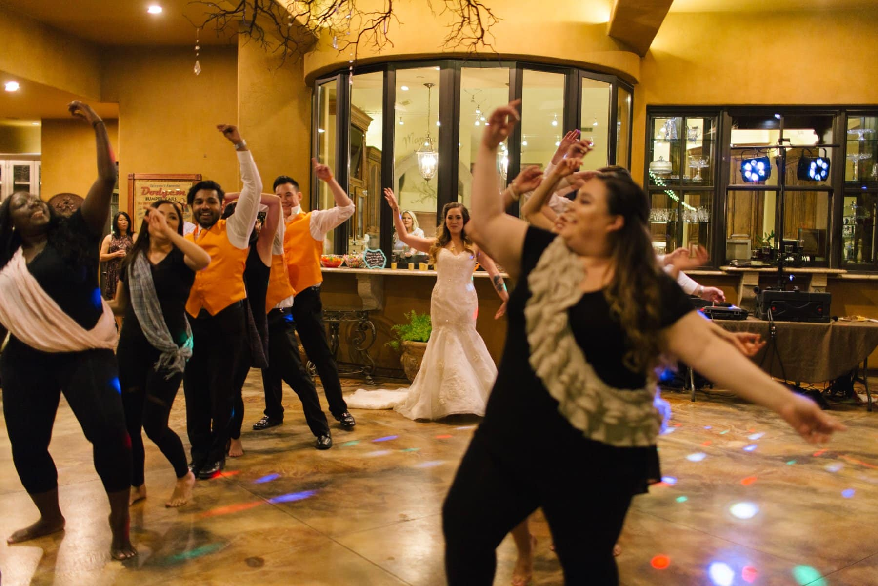 Bollywood style wedding party choreographed dance with bride for groom Phoenix South Mountain home wedding