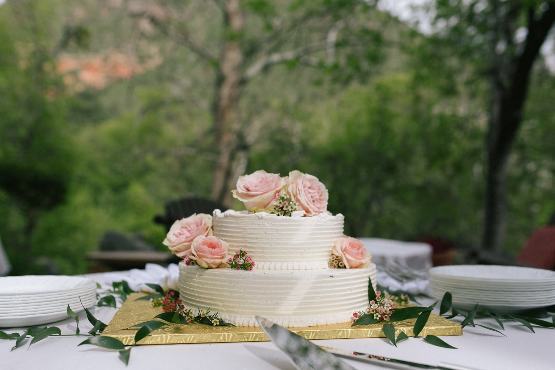 classic white small wedding cake with pink roses