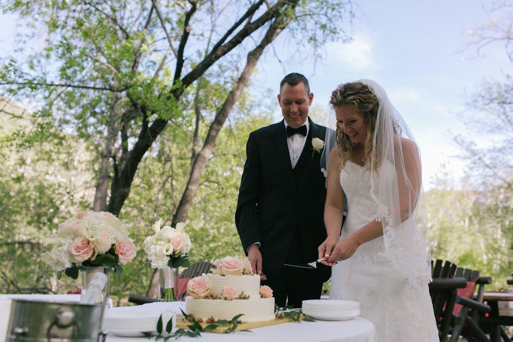 bride & groom cutting cake Briar Patch Inn Sedona wedding