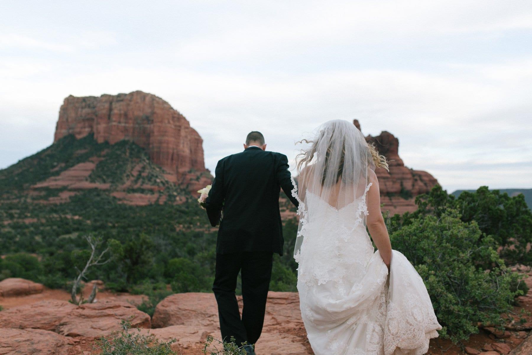 Sedona wedding photos bride & groom hiking Yavapai Lookout Trail