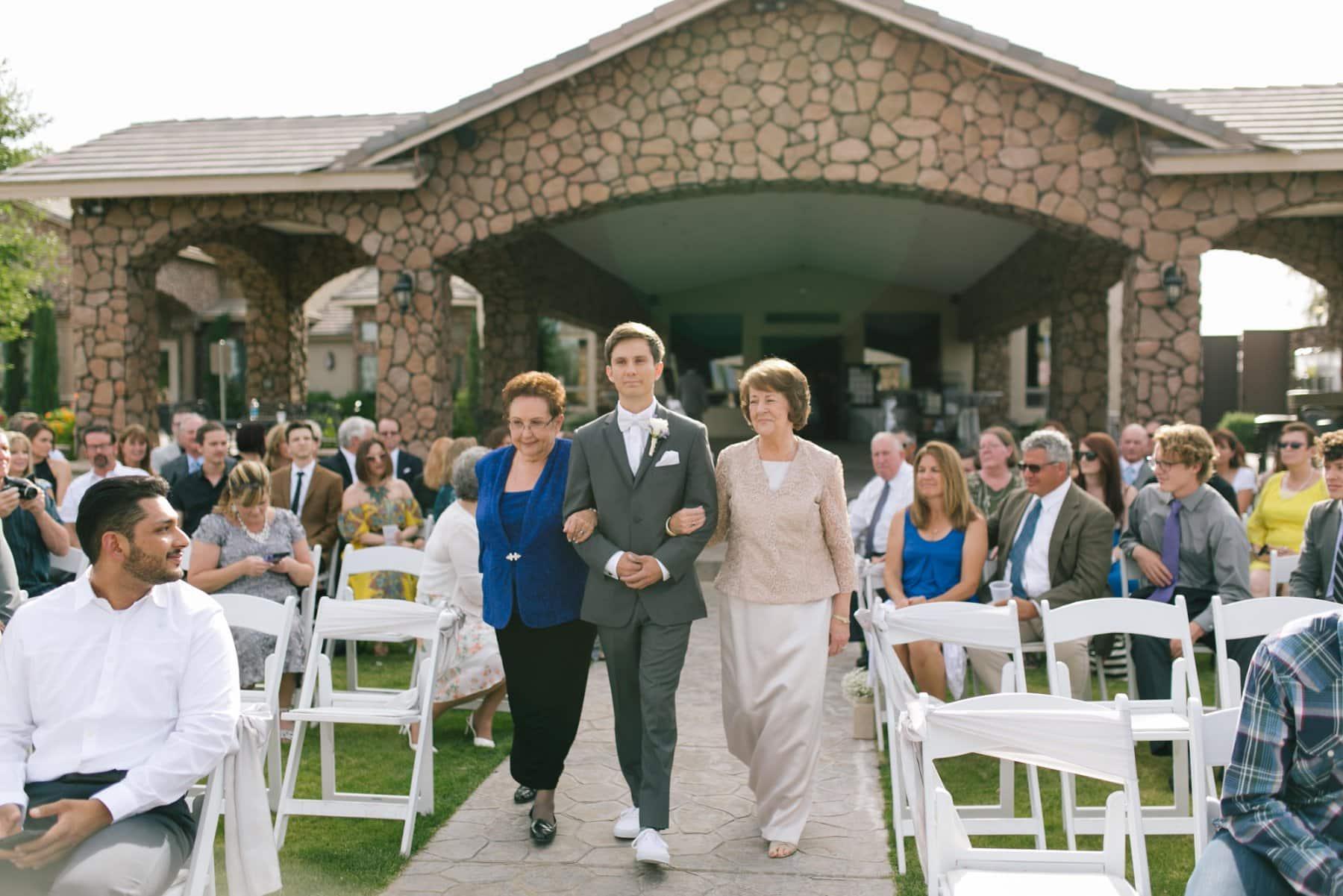 groom walking down aisle at Superstition Manor Mesa AZ wedding