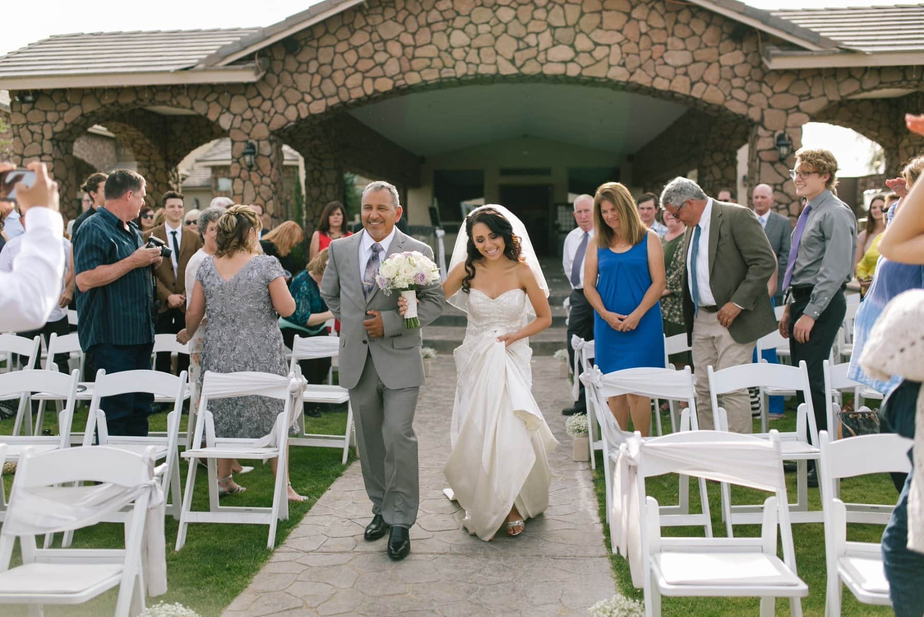 bride walking down aisle at Superstition Manor wedding