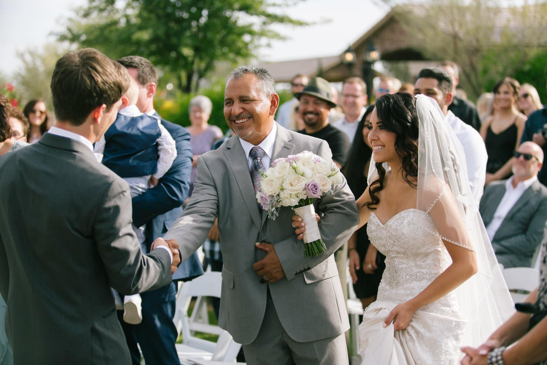 father of the bride giving away bride to groom at Superstition Manor