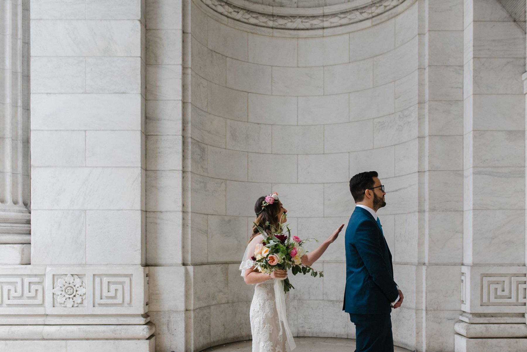 bride & groom first look at New York Public Library
