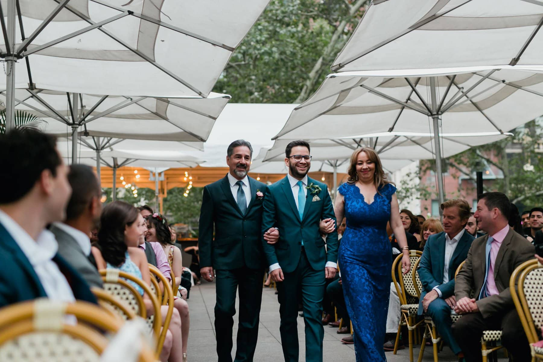 Bryant Park Grill wedding ceremony groom walking down aisle escorted by both parents
