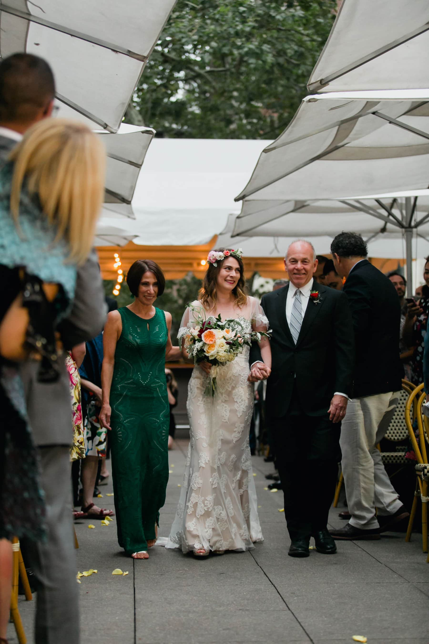 bride escorted down aisle at Bryant Park Grill by both parents