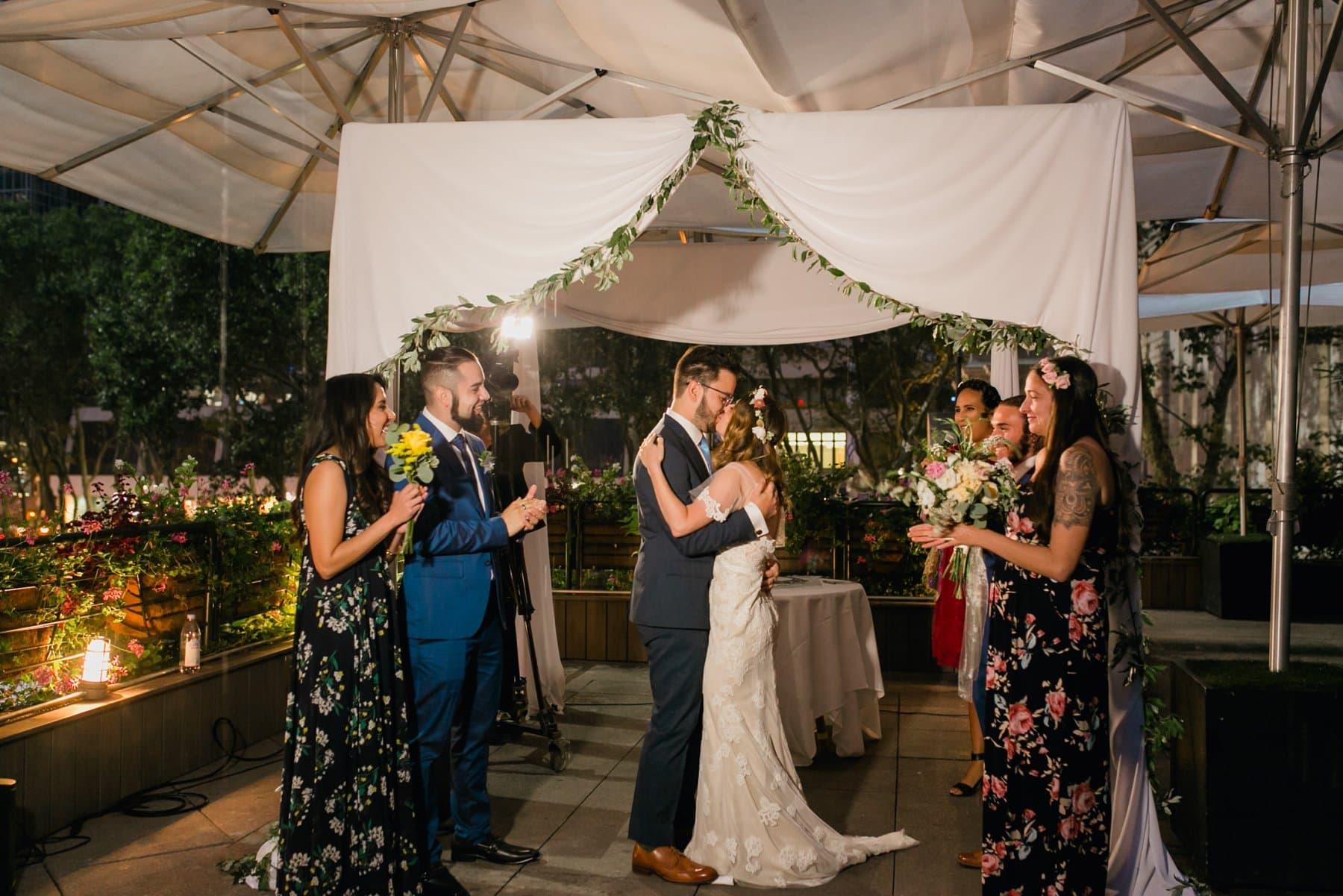 bride & groom first kiss Bryant Park Grill wedding