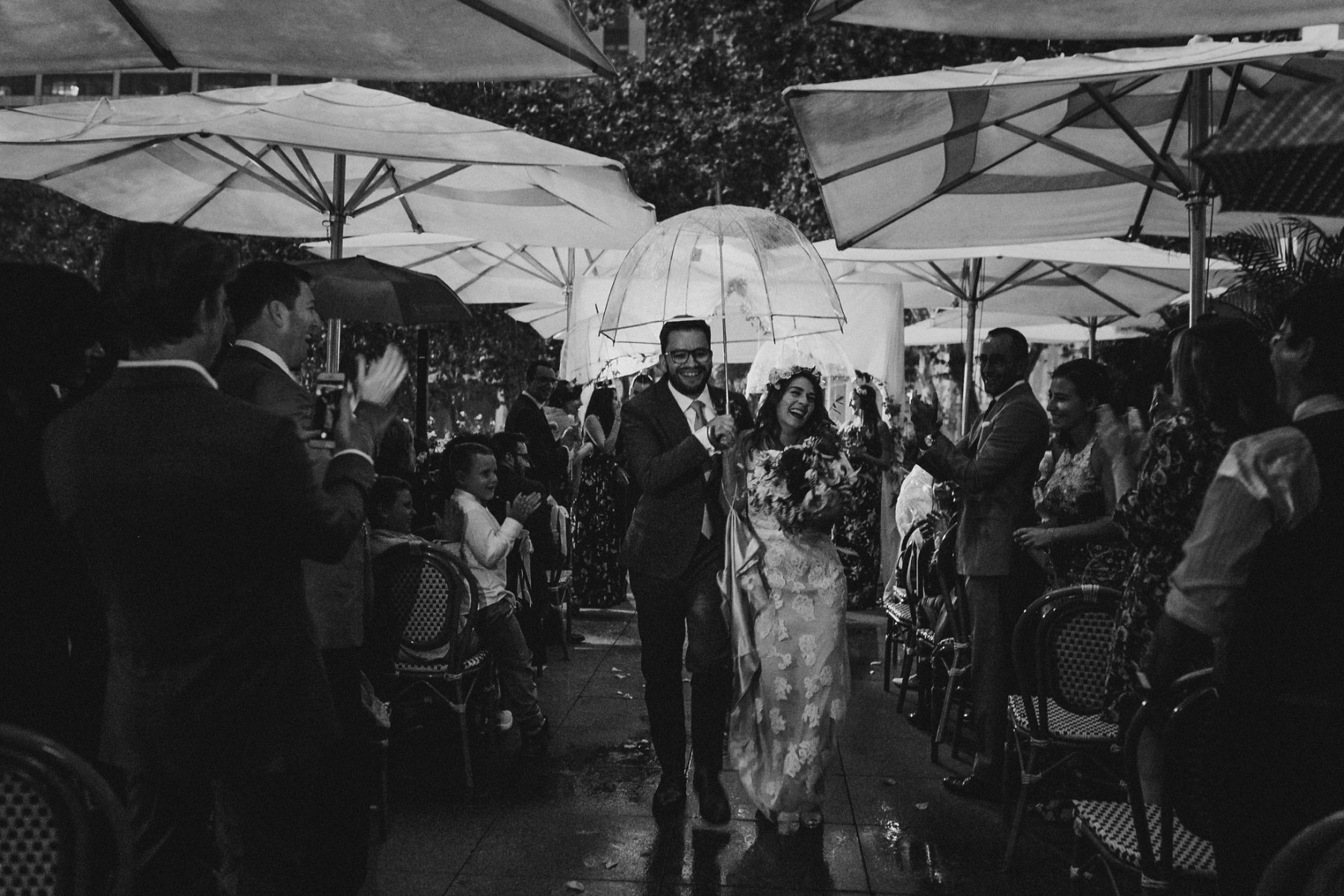 Wedding ceremony in the rain at night at Bryant Park Grill