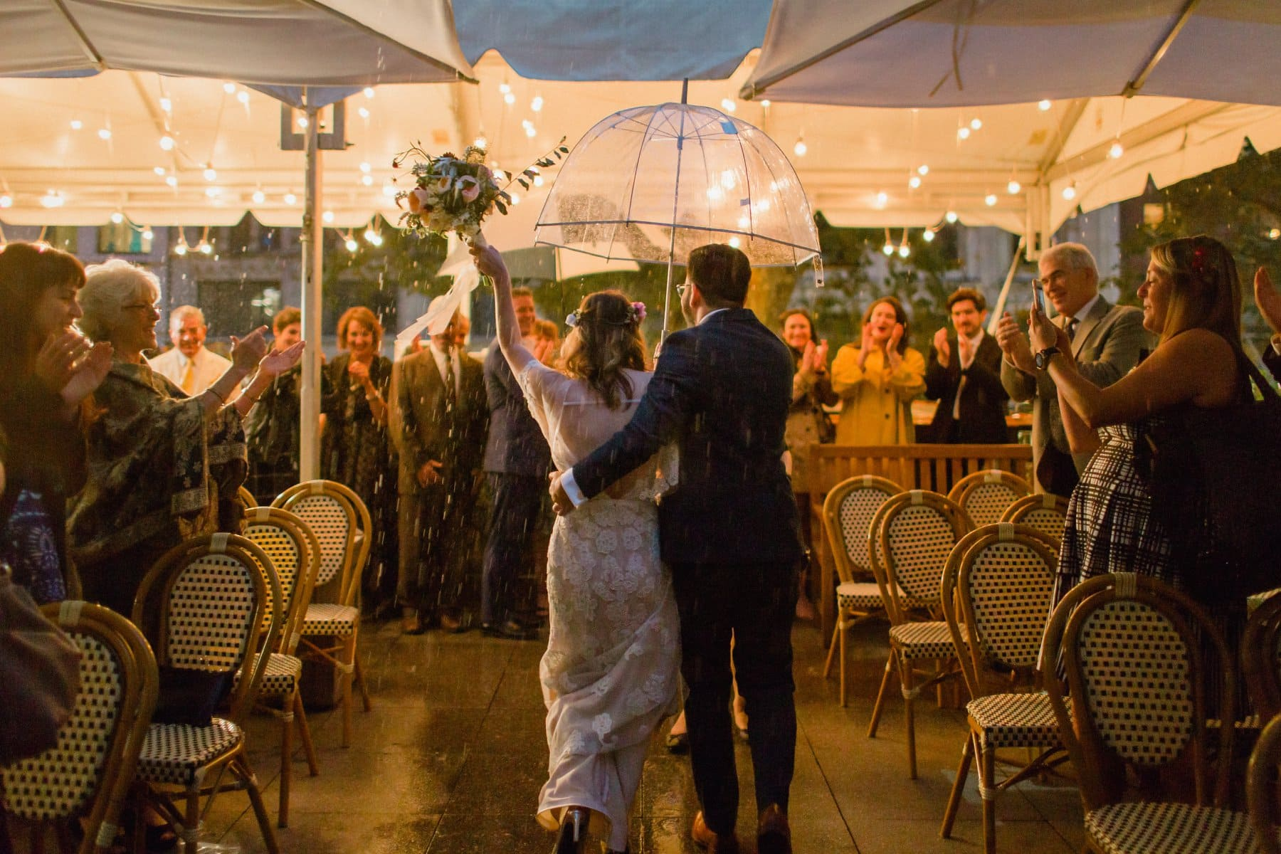 wedding recessional in the rain rooftop in New York City Bryant Park Grill