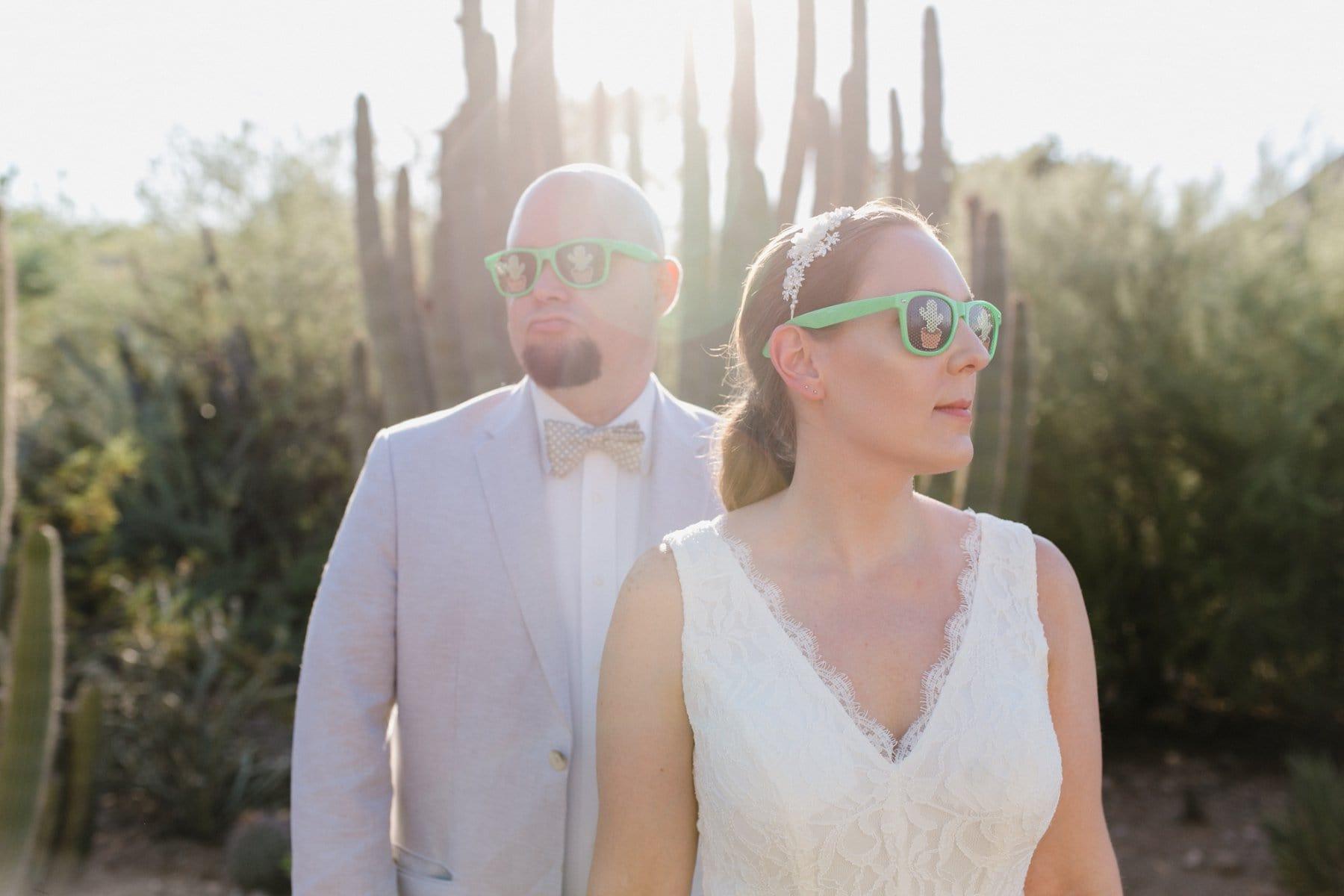 bride & groom wearing cactus sunglasses Arizona