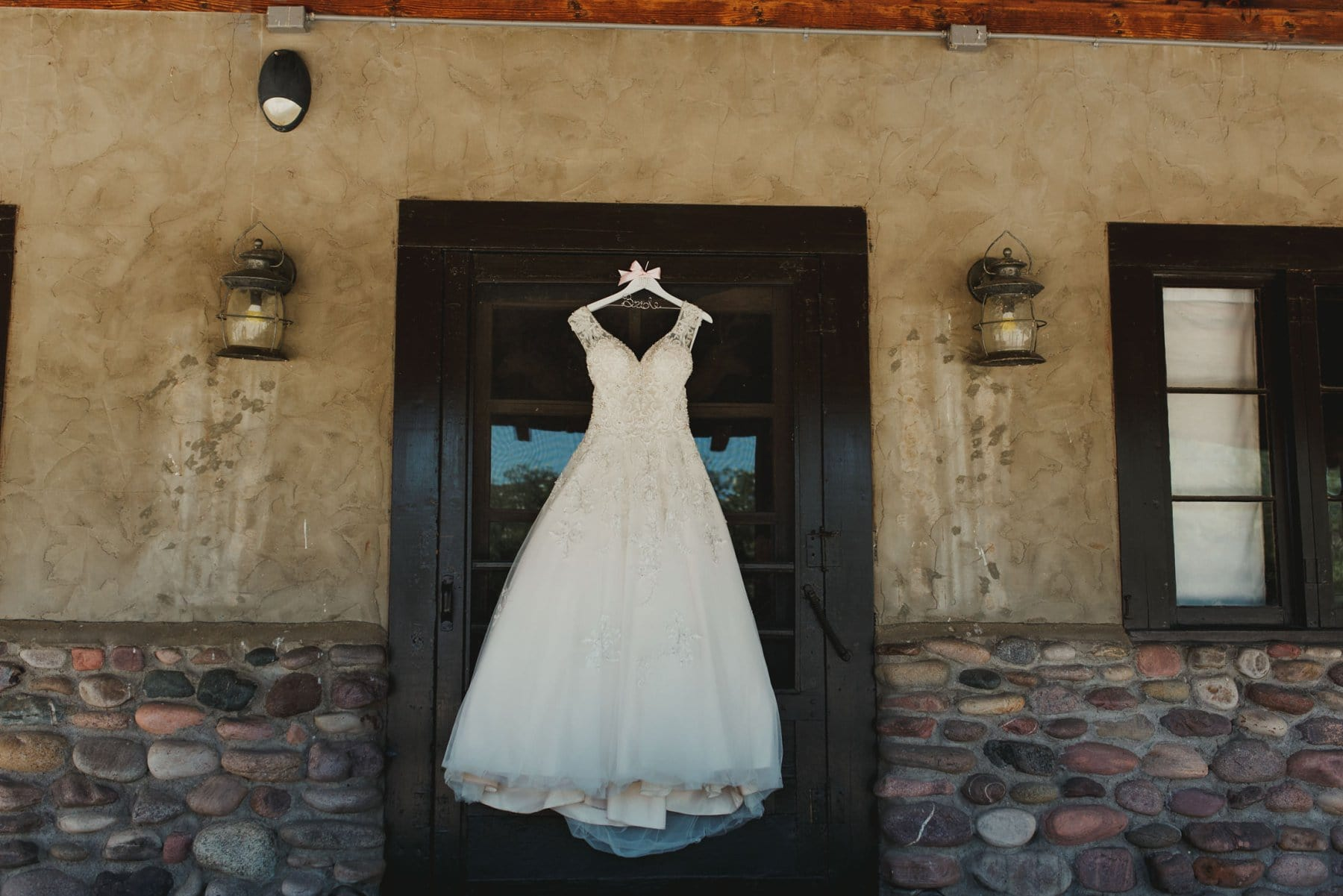 wedding dress hanging at Saguaro Lake Guest Ranch