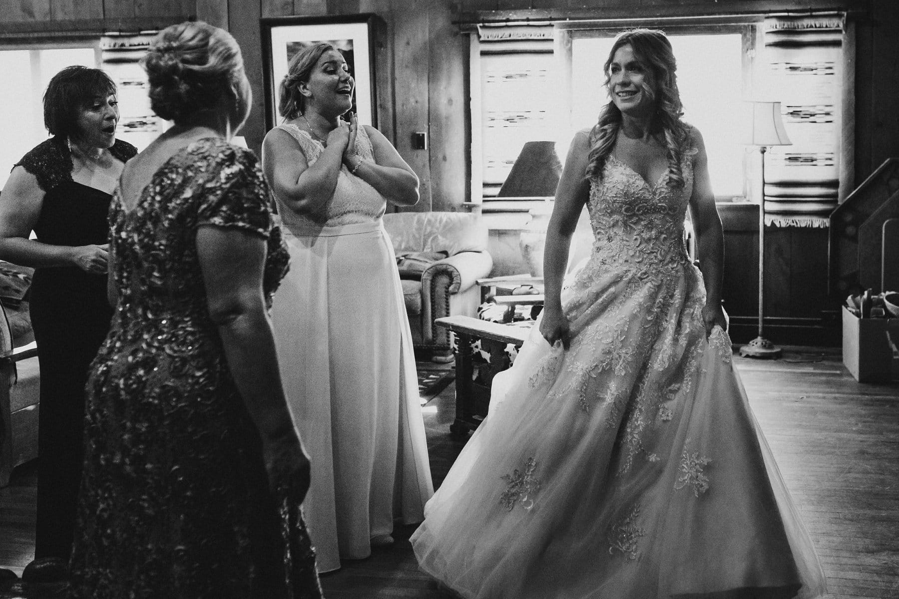 documentary photographer bridesmaid and moms seeing bride for first time at Saguaro Lake Ranch wedding