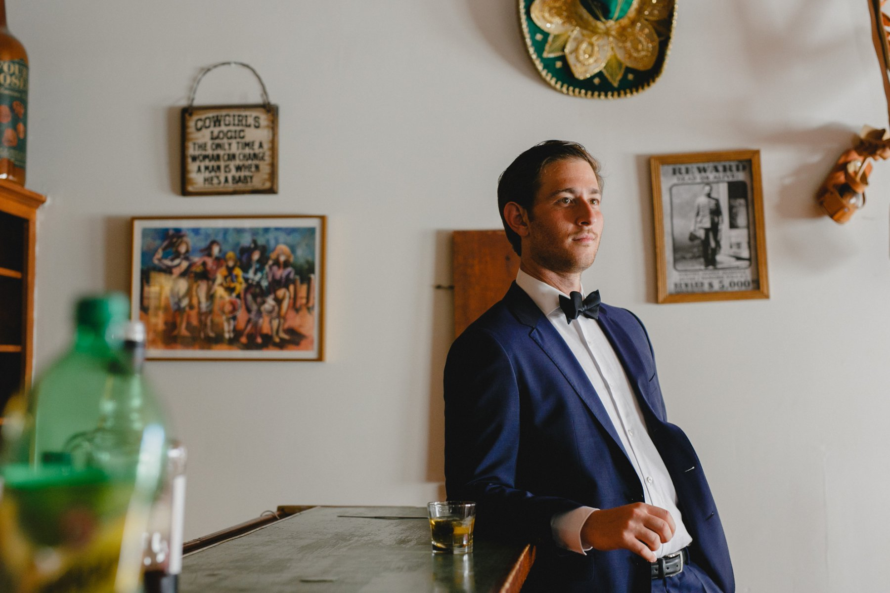 groom in vintage cowboy bar at Saguaro Lake Ranch wedding venue Mesa AZ