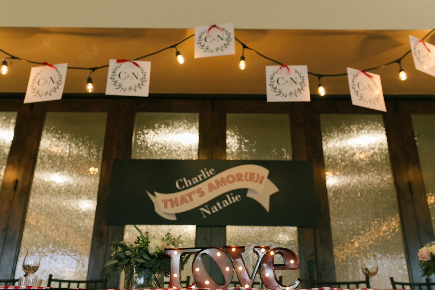 Italian themed wedding that's amore with light up love marquee sign
