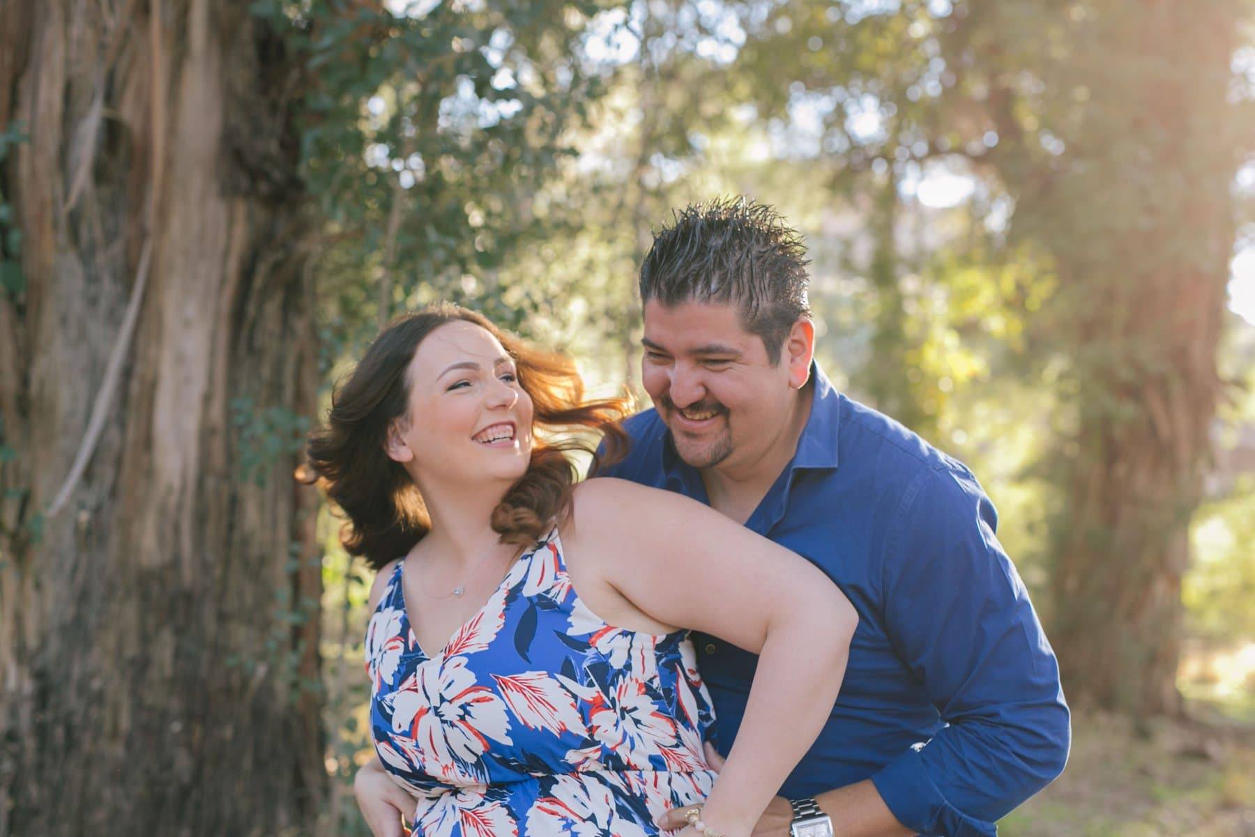 couple laughing and having fun at engagement session candid natural engagement photographer Arizona