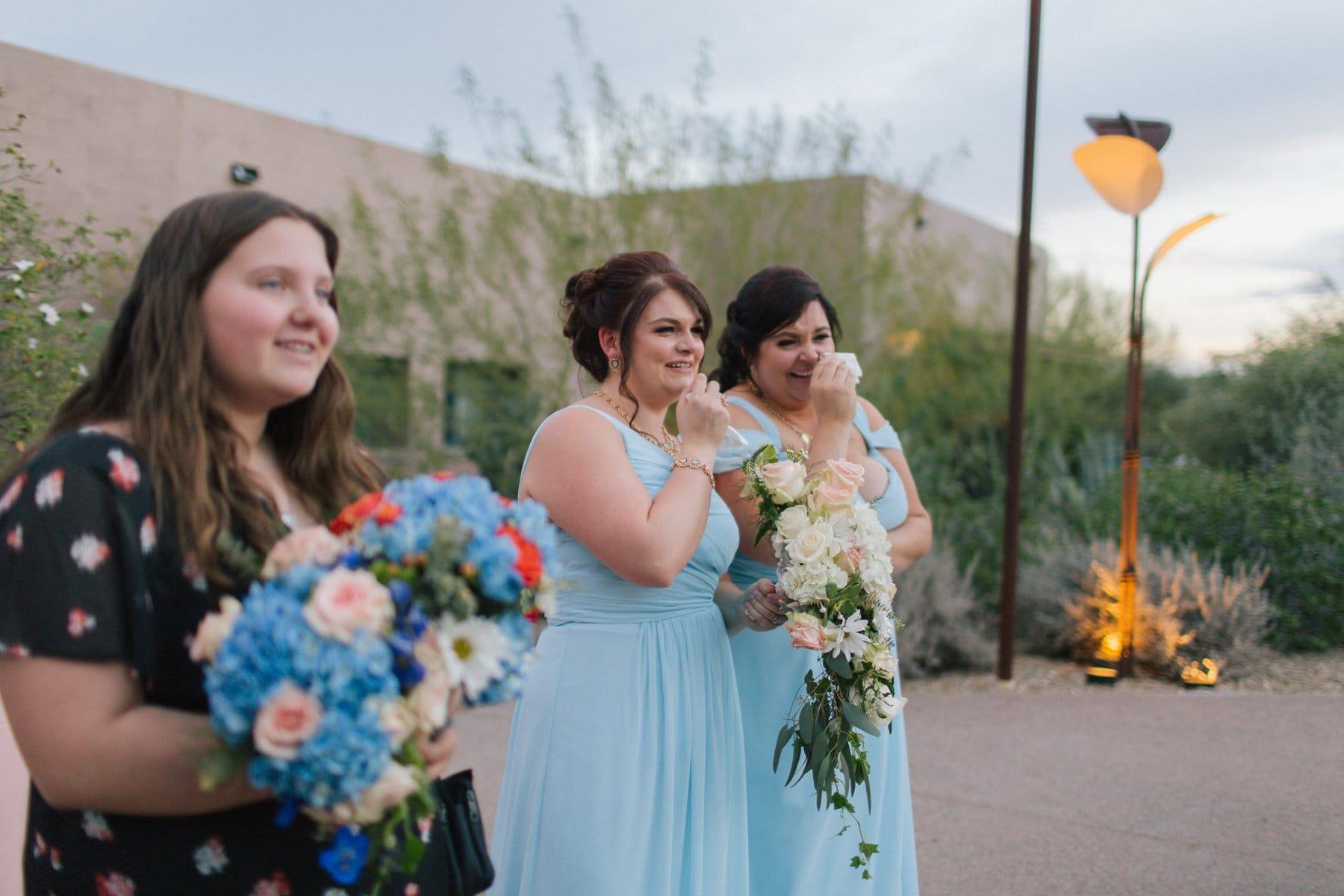 bridesmaids crying at first dance at Desert Botanical Gardens Phoenix documentary wedding photographer