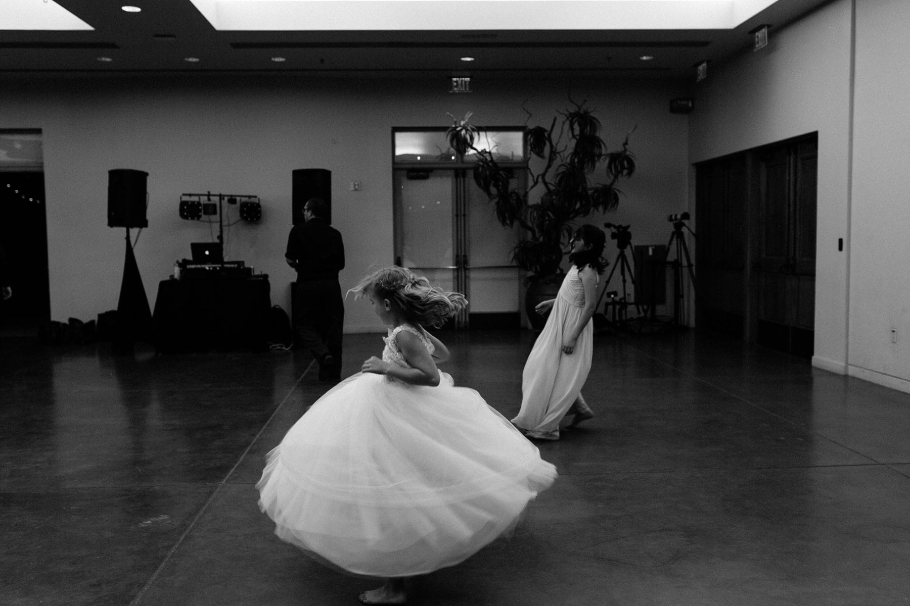 flowergirls twirling in dresses Phoenix photojournalistic photographer