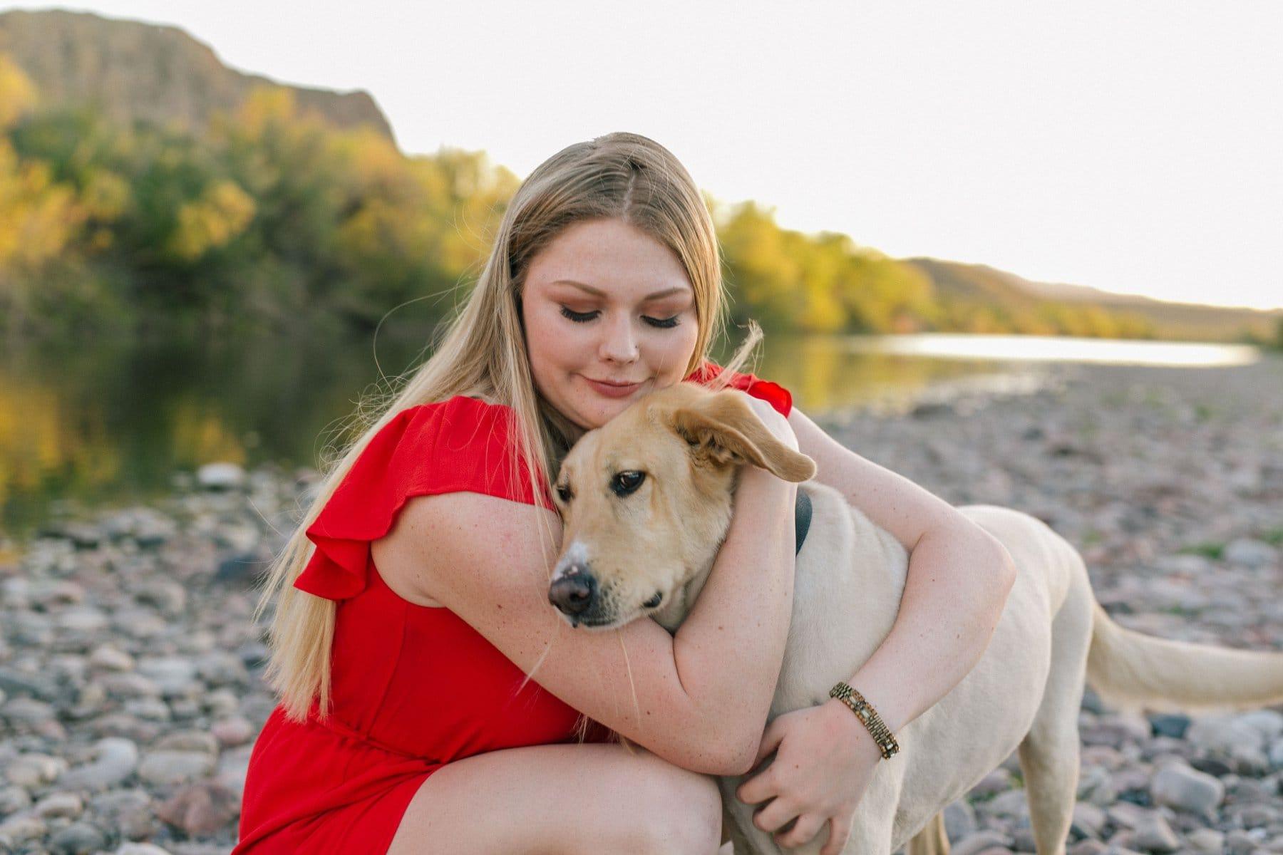 high school senior girl with dog at Salt River, Mesa