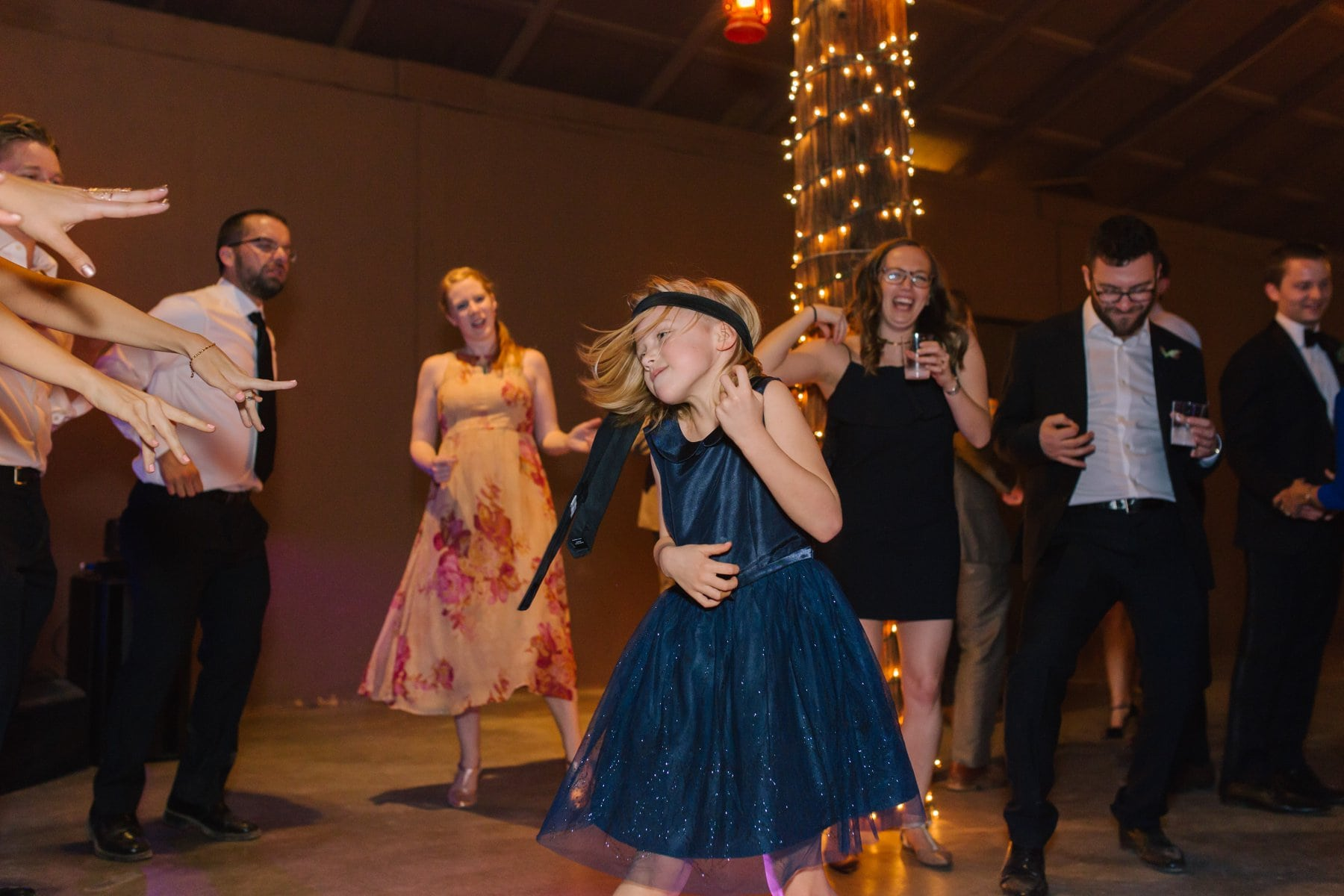 little girl rocking at wedding reception Desert Foothills wedding