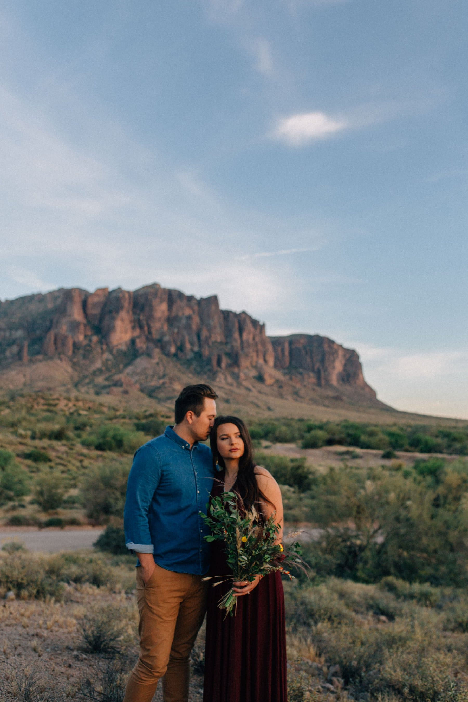 Superstition Mountains desert wild elopement in maroon dress and casual clothes