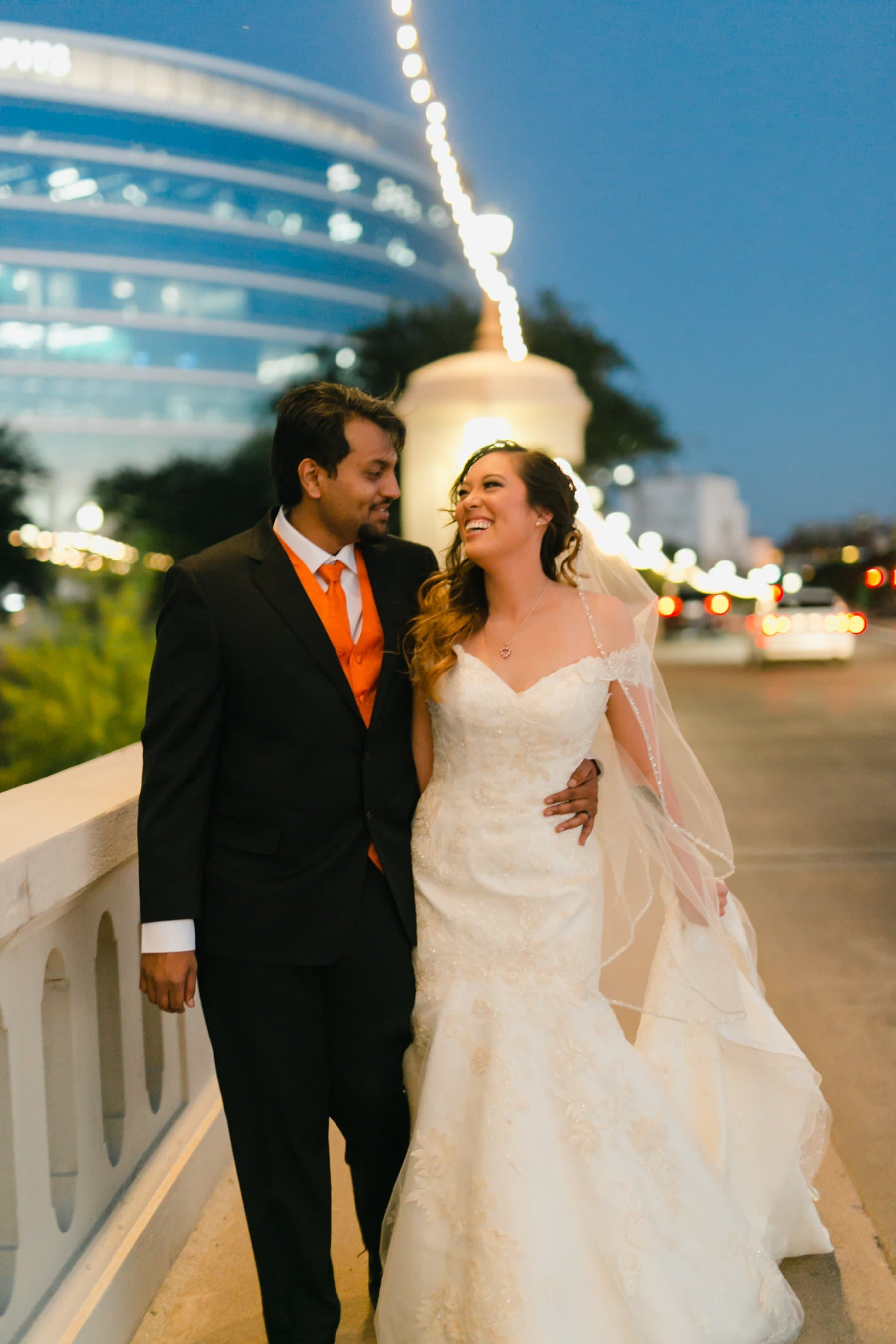 natural candid laughing bride & groom on Tempe Town Lake bridge
