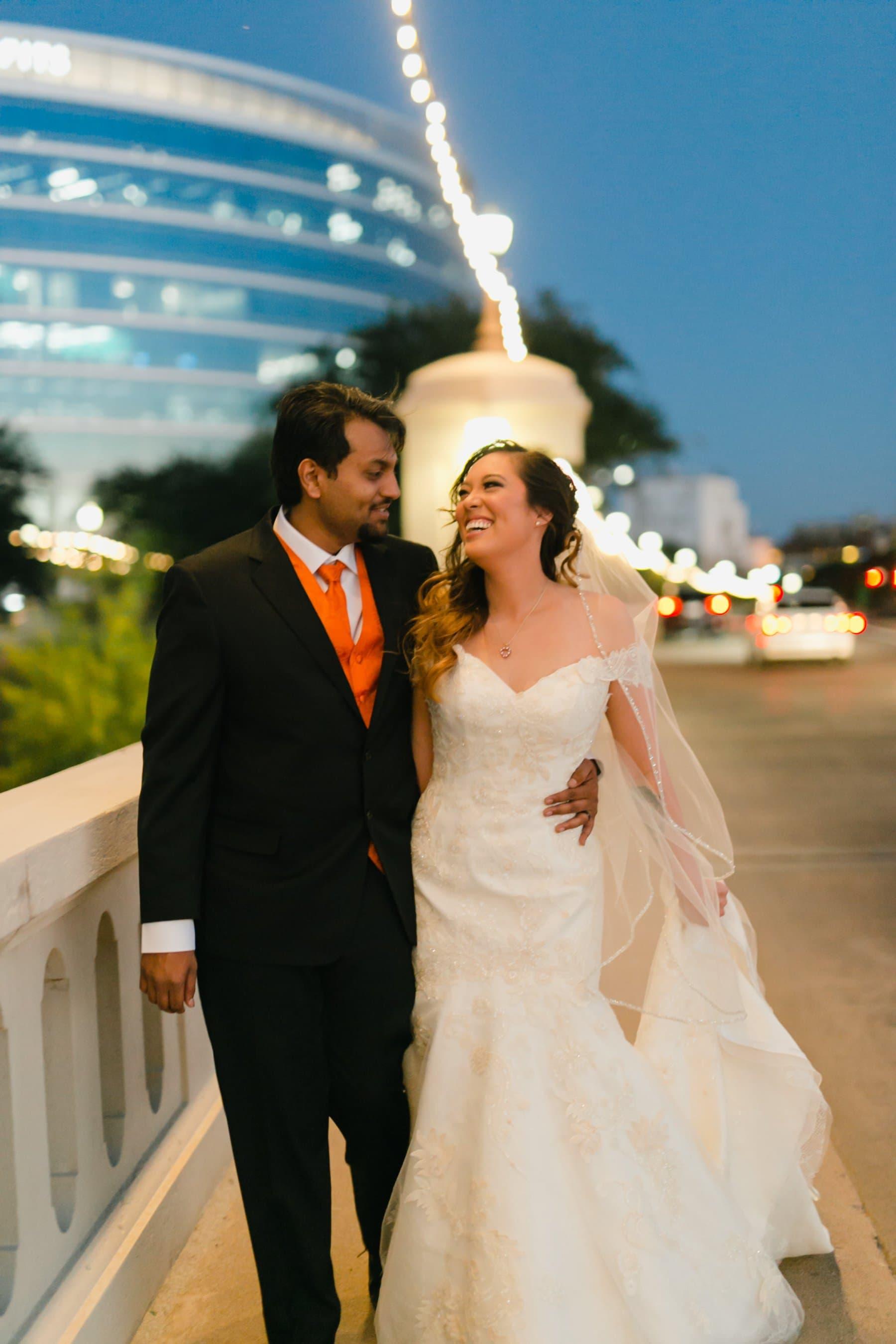 natural candid laughing bride & groom on Tempe Town Lake bridge