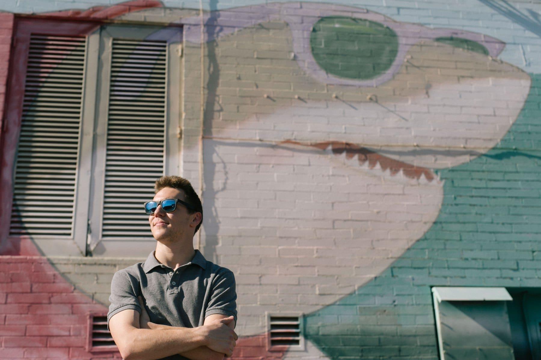college senior graduate casual photos with sunglasses & a shark mural cool college senior guy photos