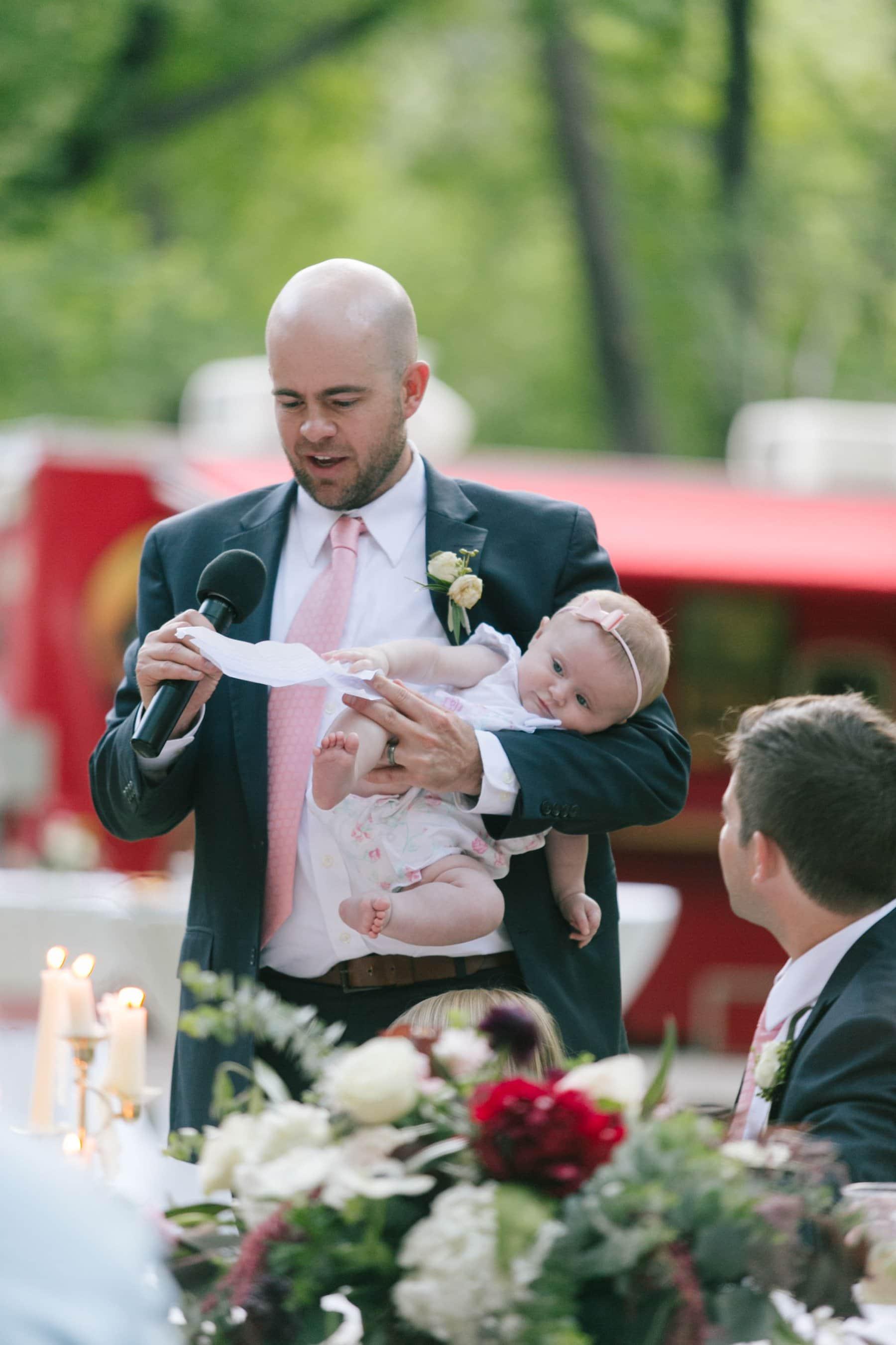 best man speech holding infant trying to grab speech Juinipine wedding photos Sedona
