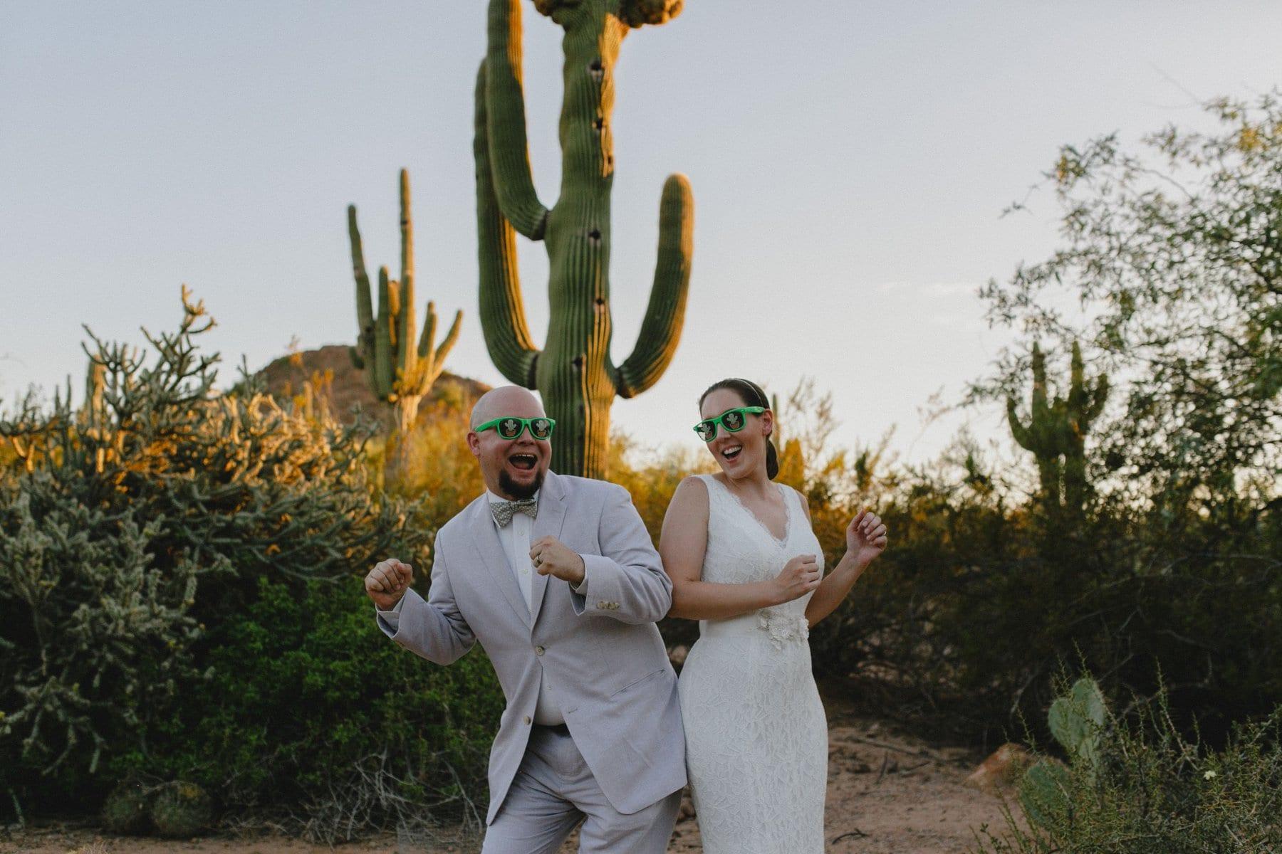 happy fun goofy joyful wedding photos with cactus sunglasses at Desert Botanical elopement