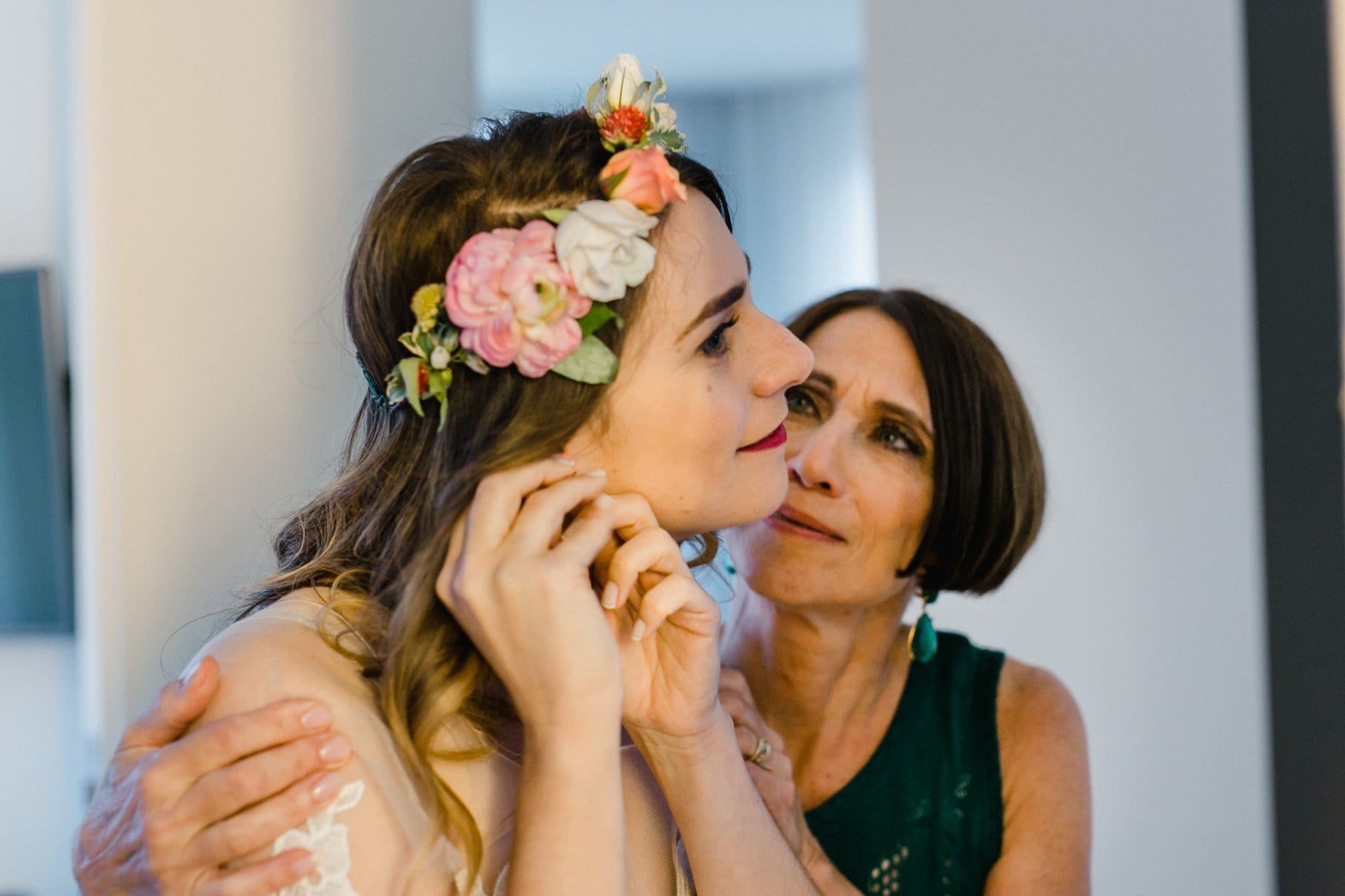 mom looking at bride getting ready adoringly Manhattan garden party wedding
