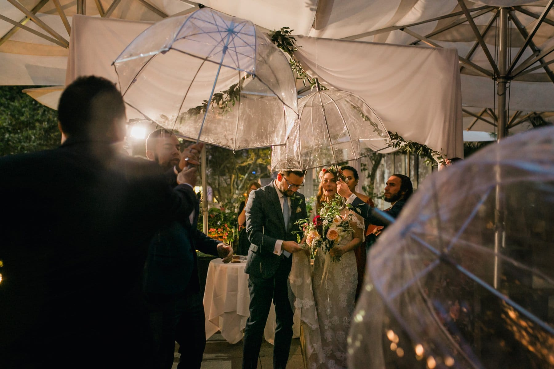 ceremony in the rain at night Bryant Park wedding ceremony New York City