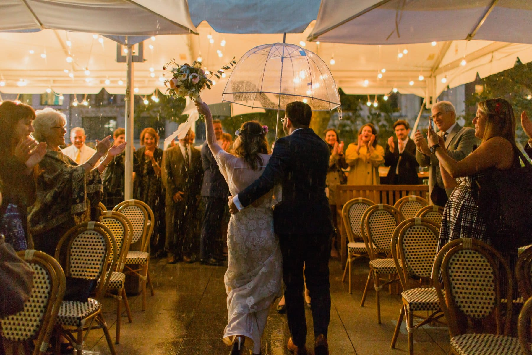 triumphant rainy recessional night time wedding ceremony Bryant Park Grill wedding