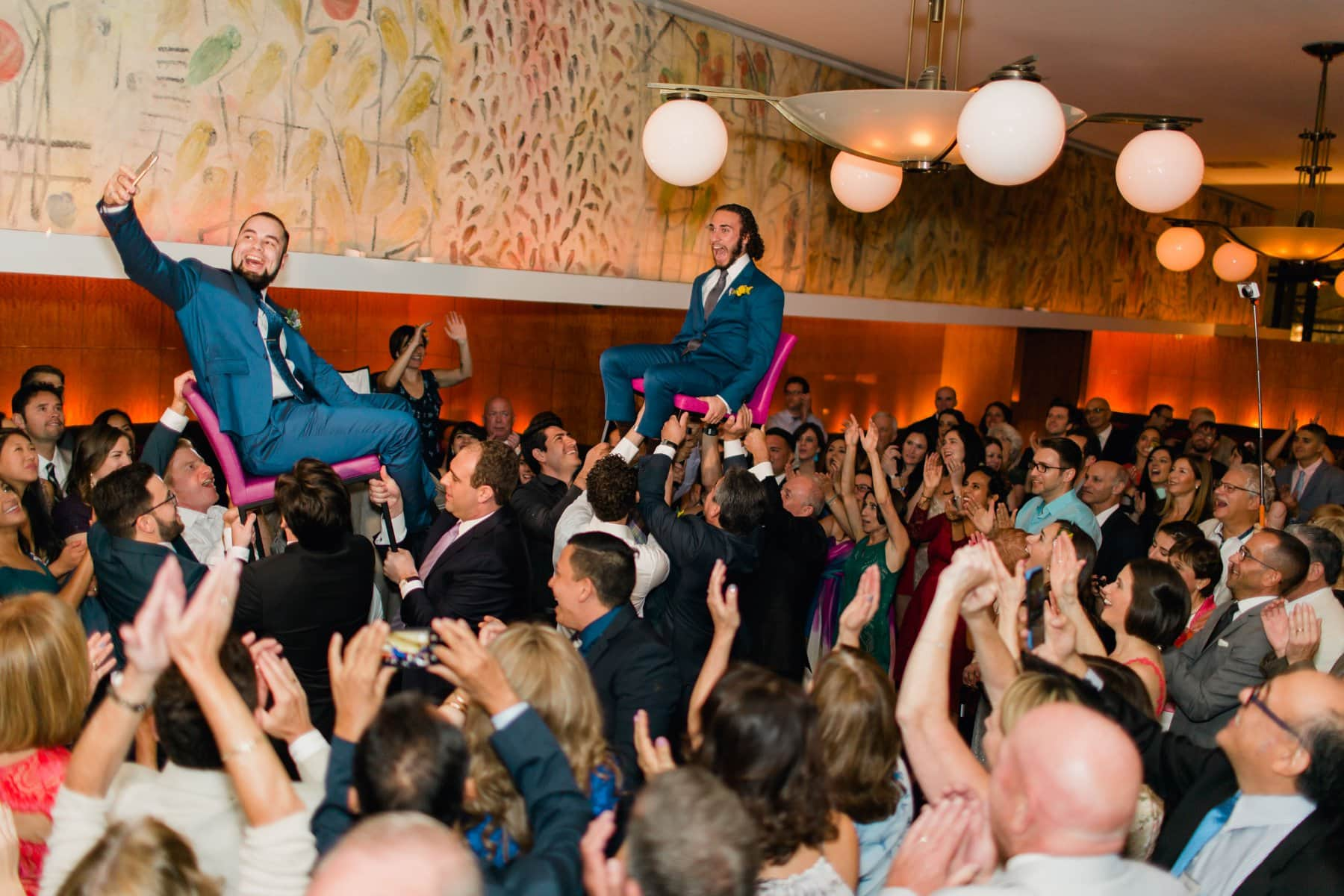crazy hora groomsman taking selfie Bryant Park Grill New York wedding
