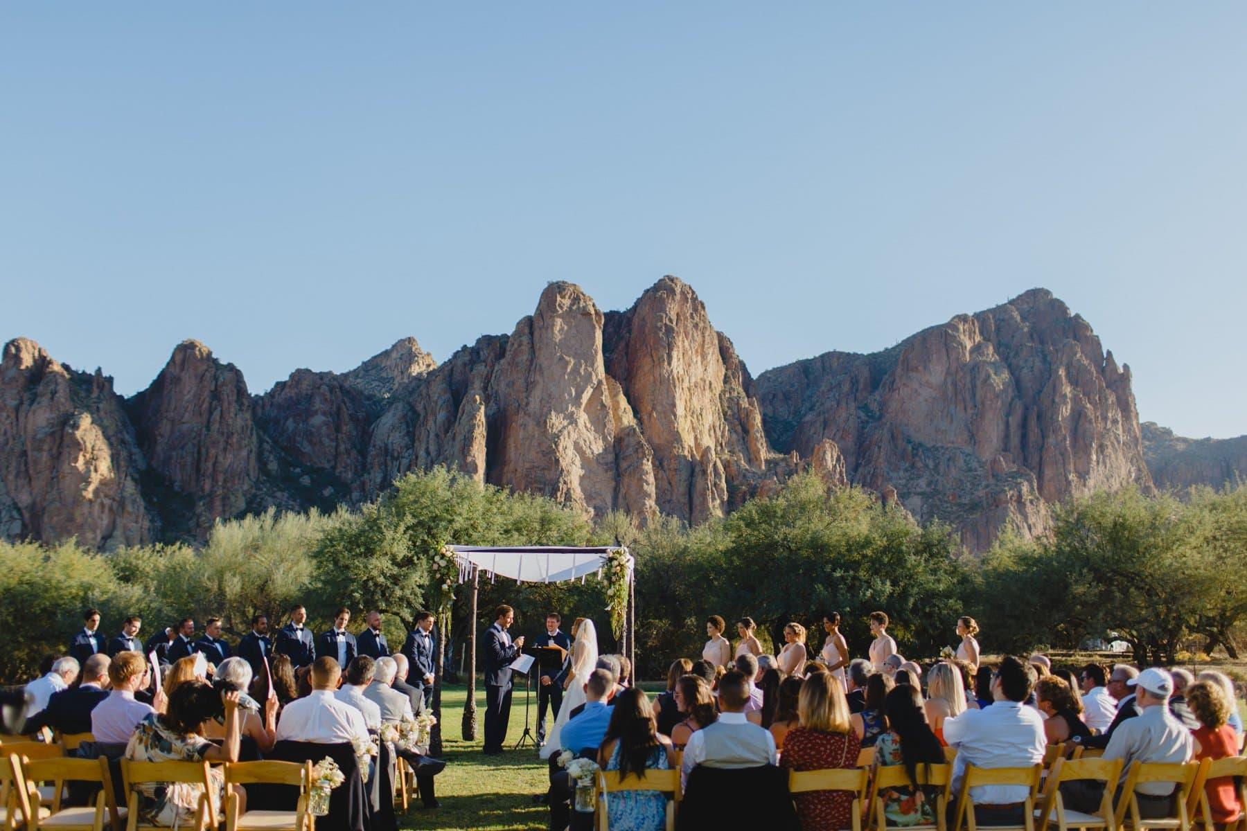 Saguaro Lake Ranch wedding ceremony with mountains in background Arizona