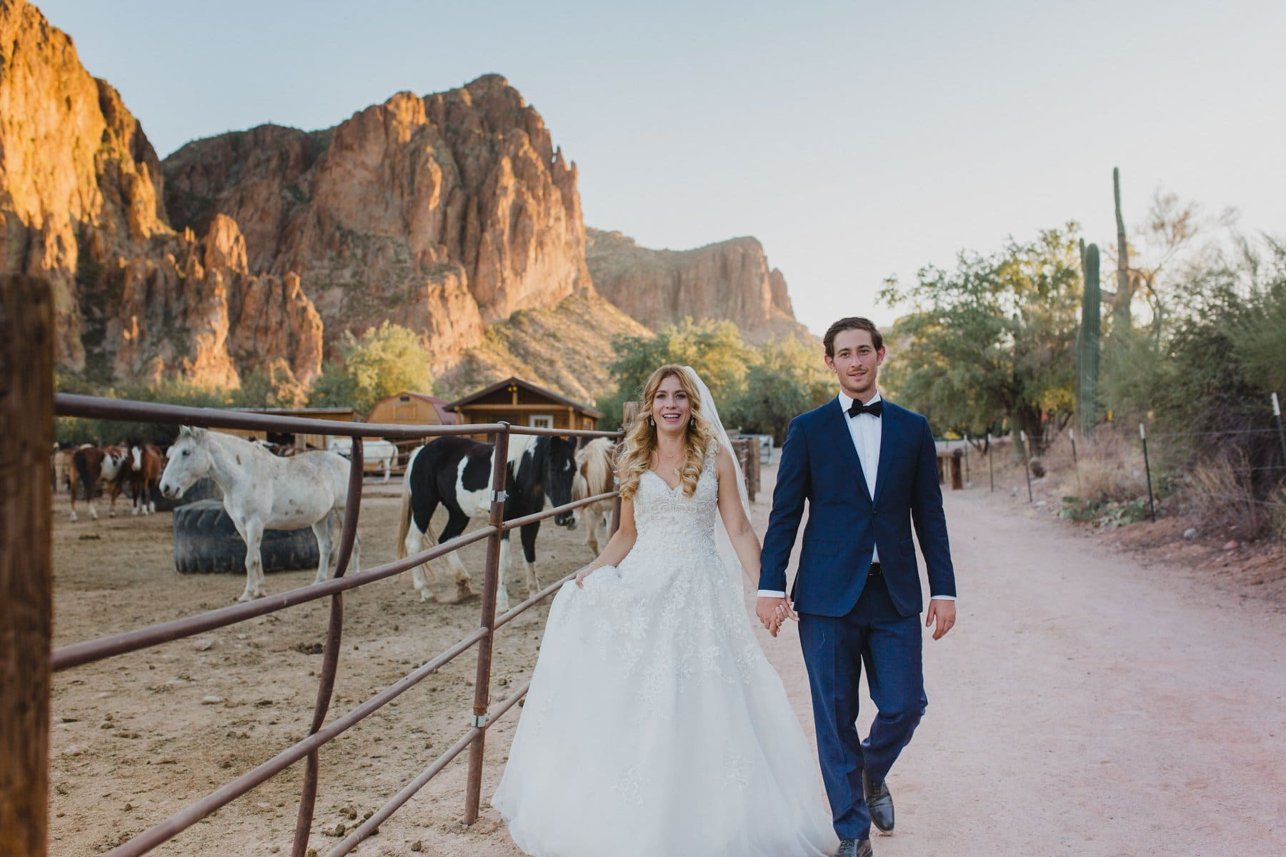 Saguaro Lake Ranch wedding photos horses mountains at sunset