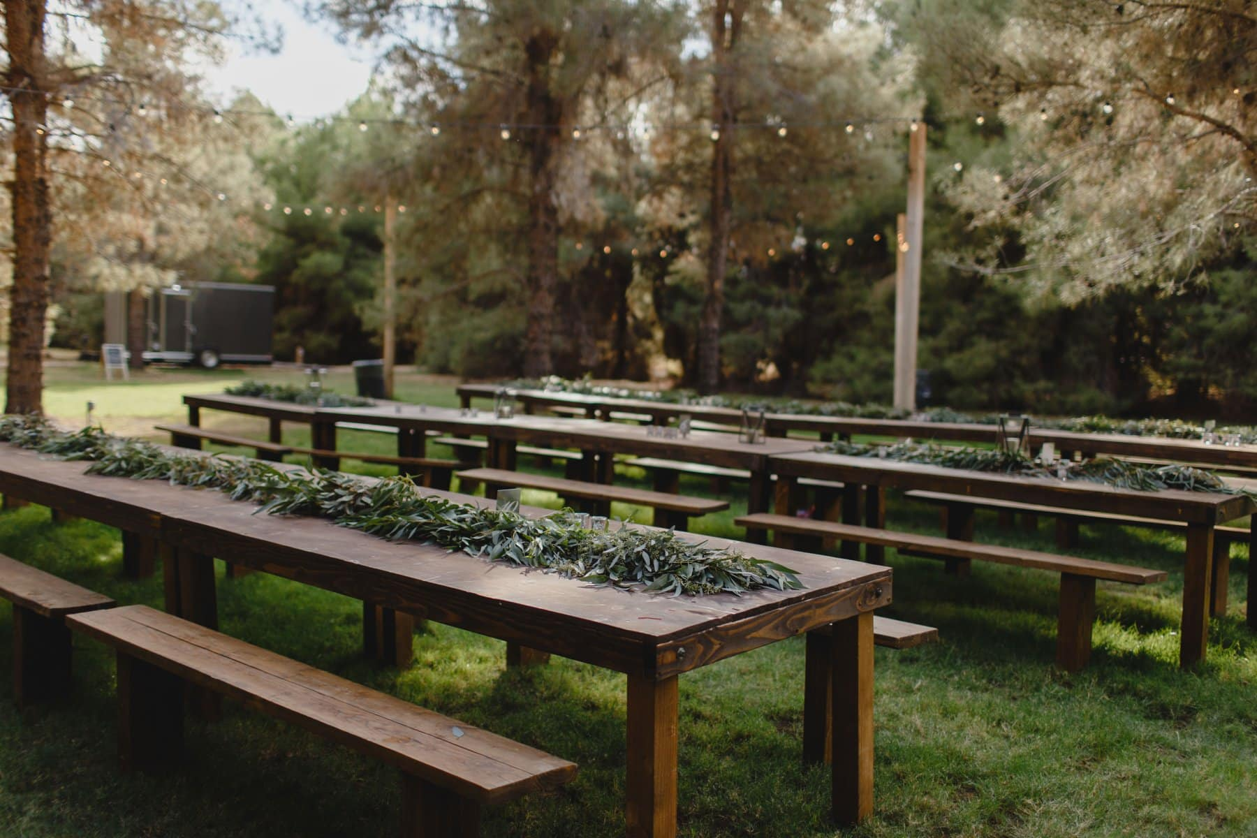 forest wedding in Phoenix with rustic wood reception tables