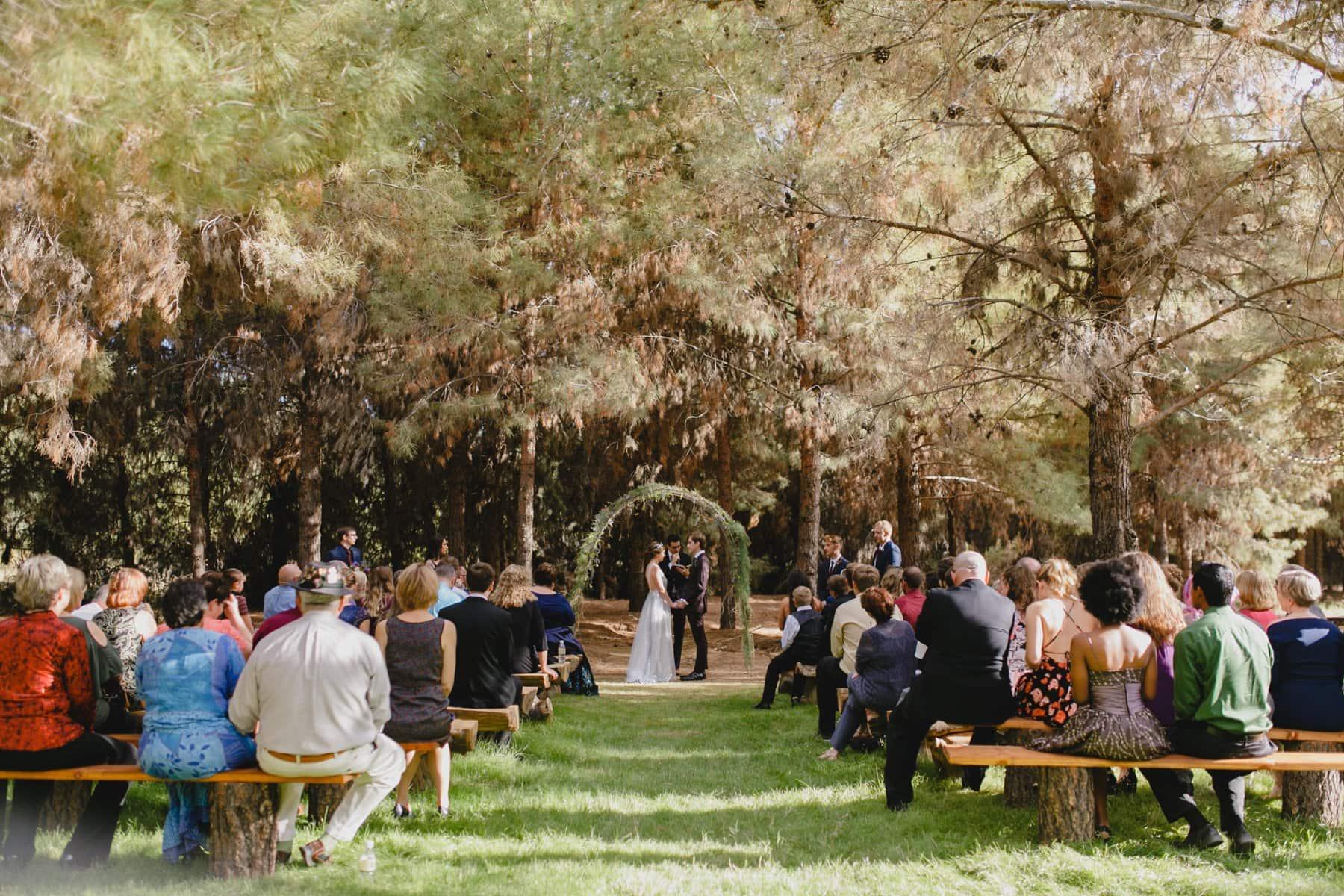 rustic outdoor wedding ceremony at the Meadow Schnepf Farms AZ