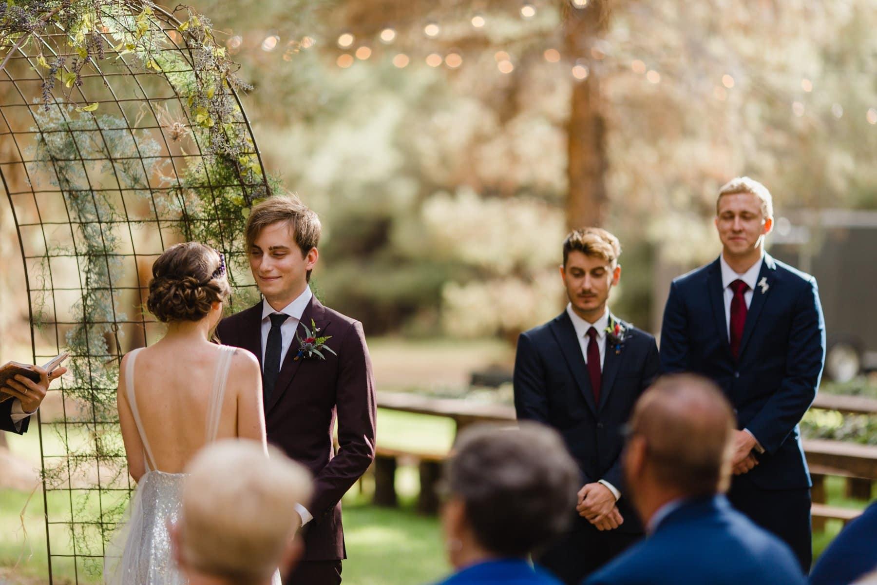 wedding ceremony at the Meadows Schnepf Farms rustic outdoor pine tree venue