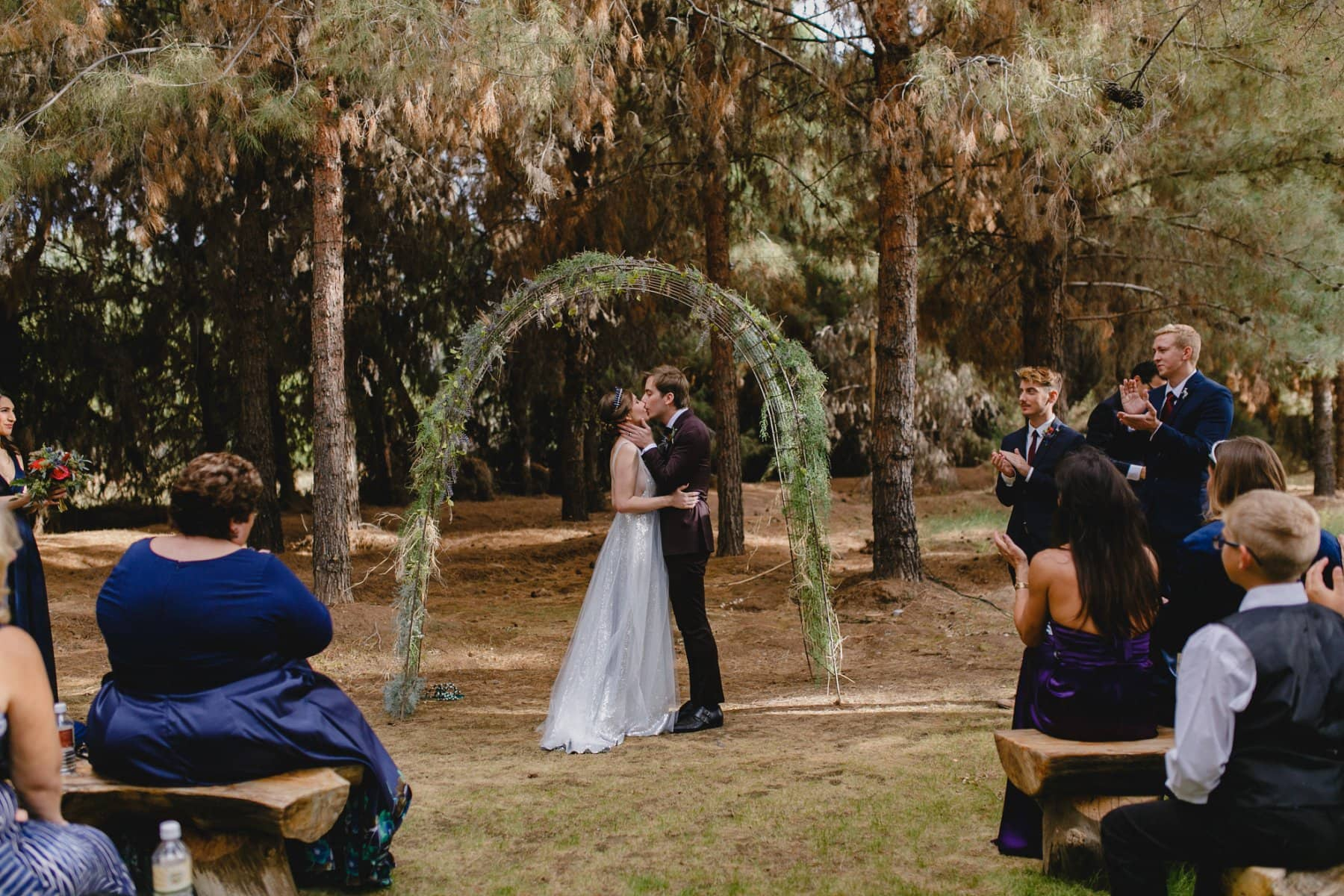 first kiss at wedding ceremony at the Meadow Schnepf Farm