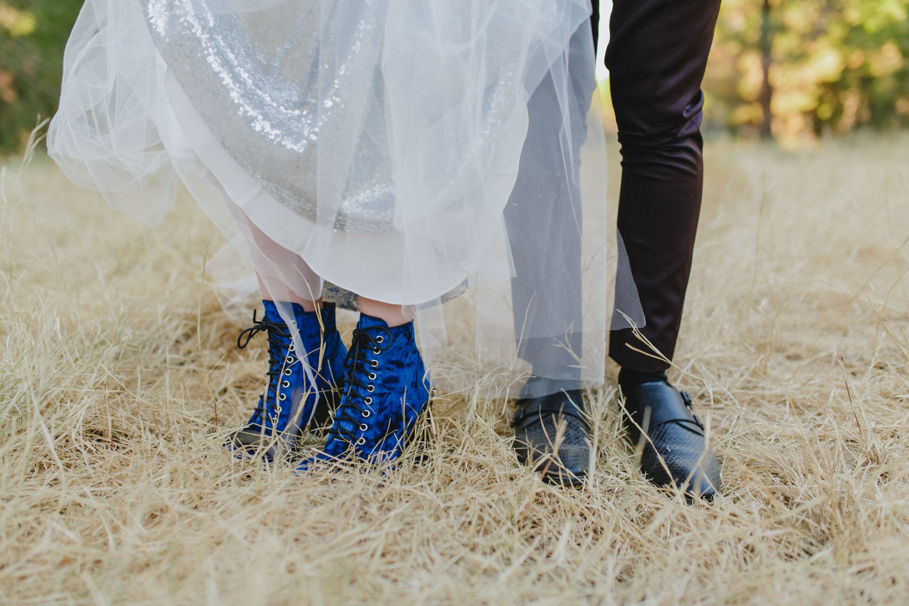 alternative wedding at Schnepf Farms bridal blue suede boots