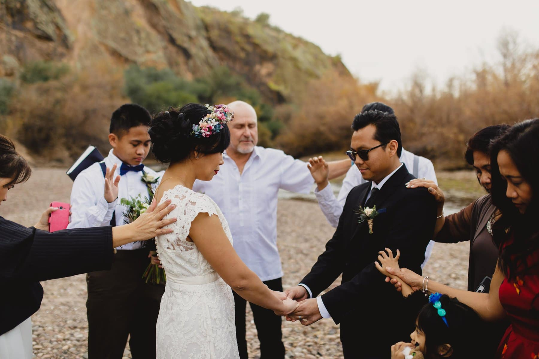 laying of the hands wedding ceremony outdoor Salt River wedding Arizona