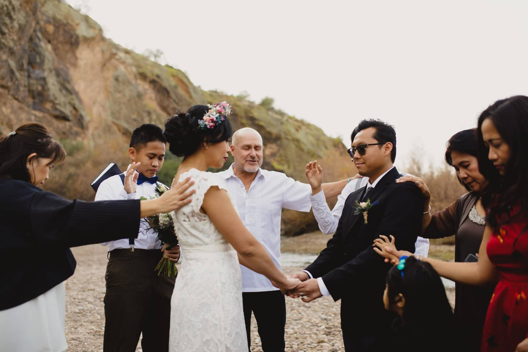 laying of the hands outdoor small wedding ceremony at Salt River in Arizona