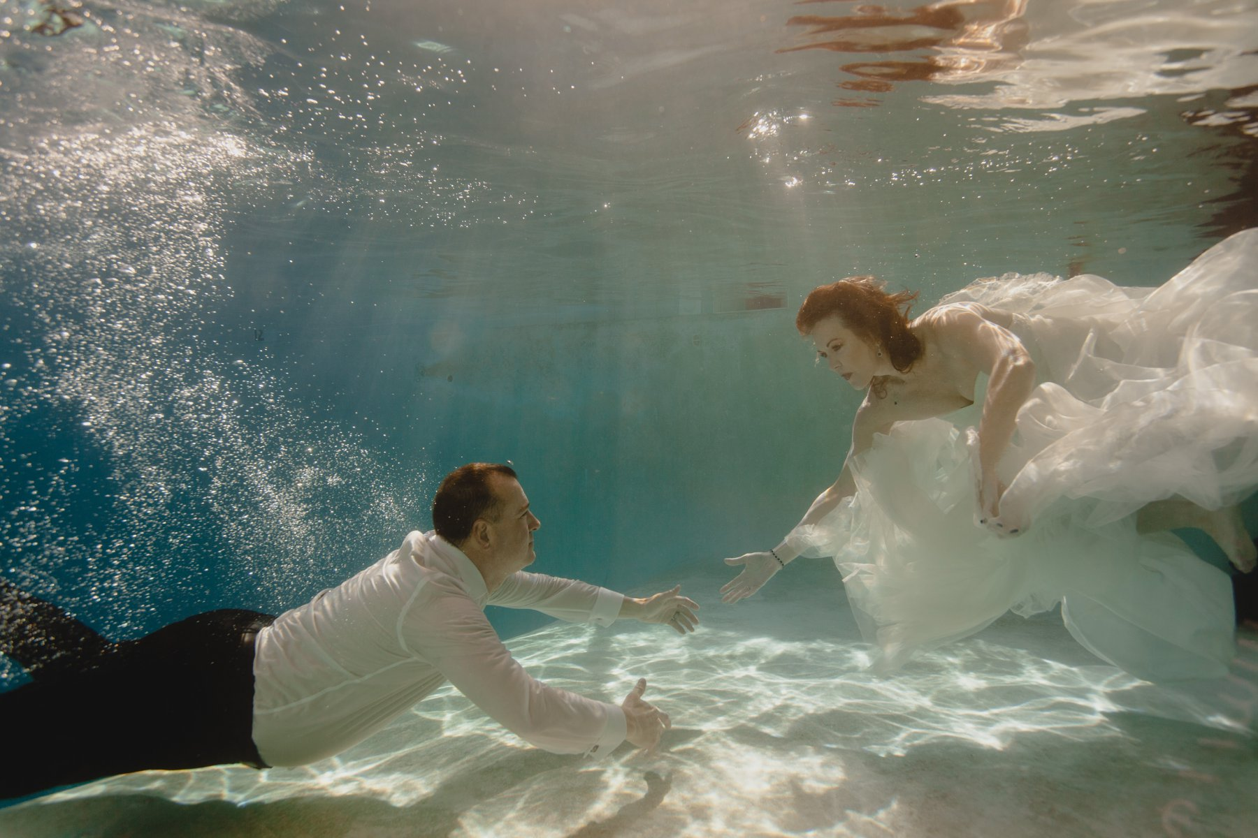 adventurous creative underwater elopement photos
