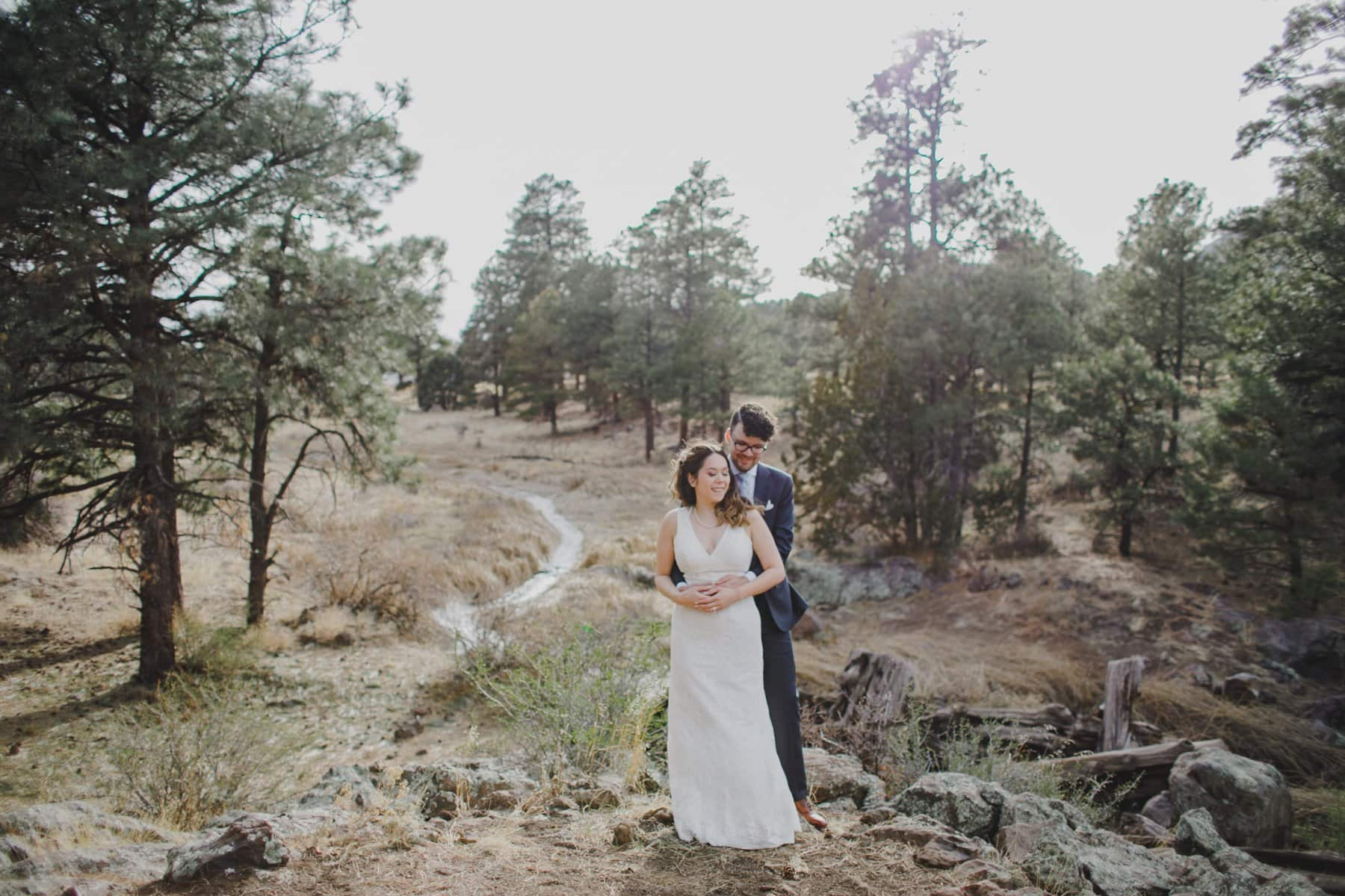 Flagstaff elopement along a creek with pine trees