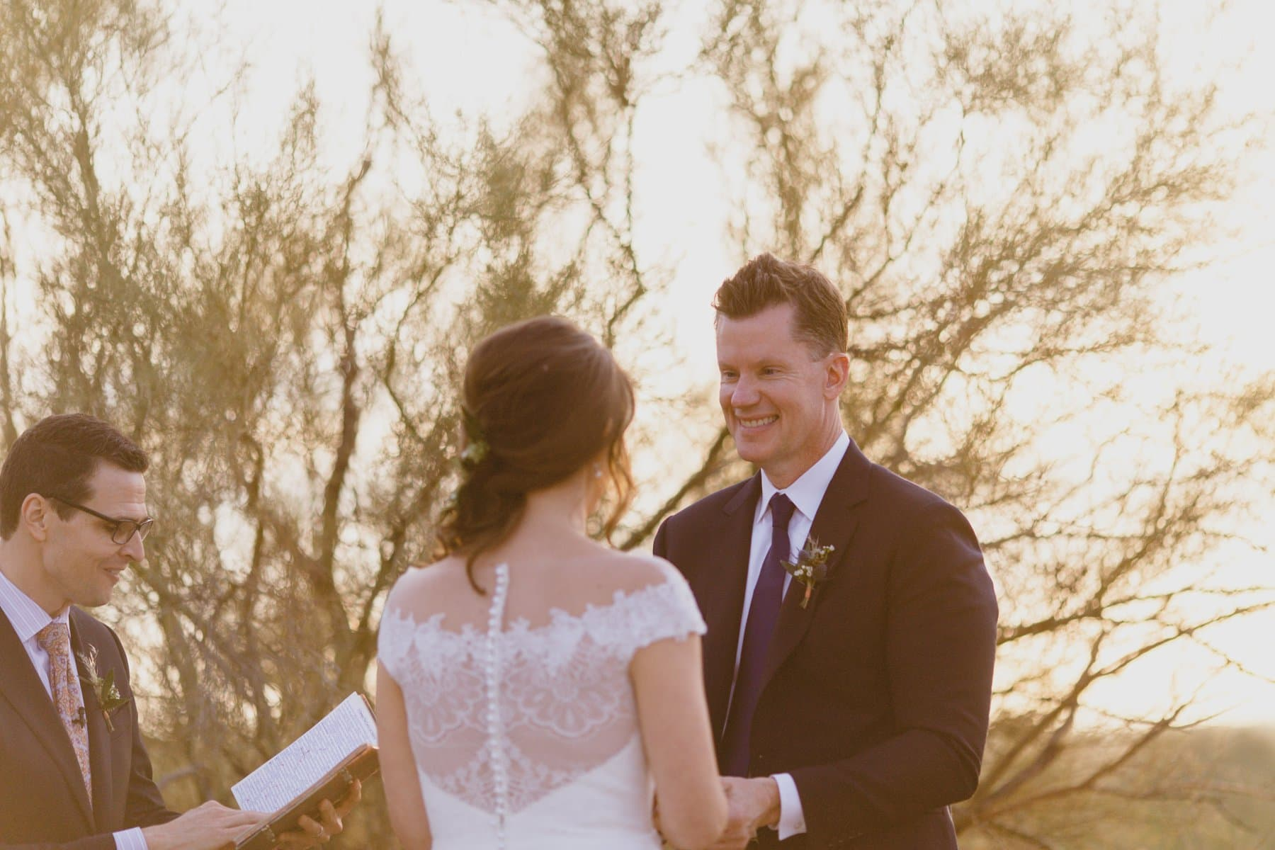 Arizona elopement in desert at Superstition Mountains groom looking at bride