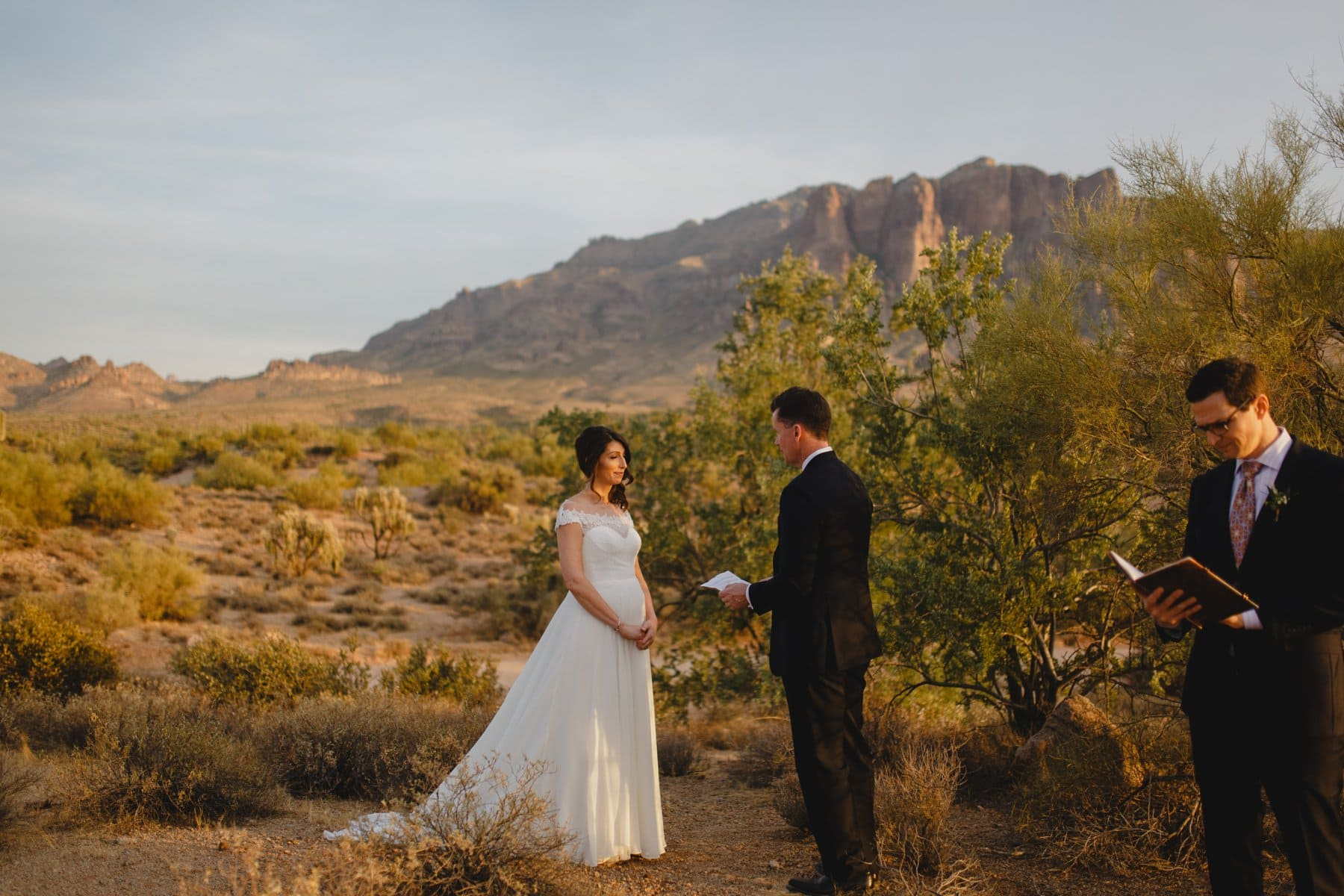 exchanging vows Arizona Superstition Mountains at sunset